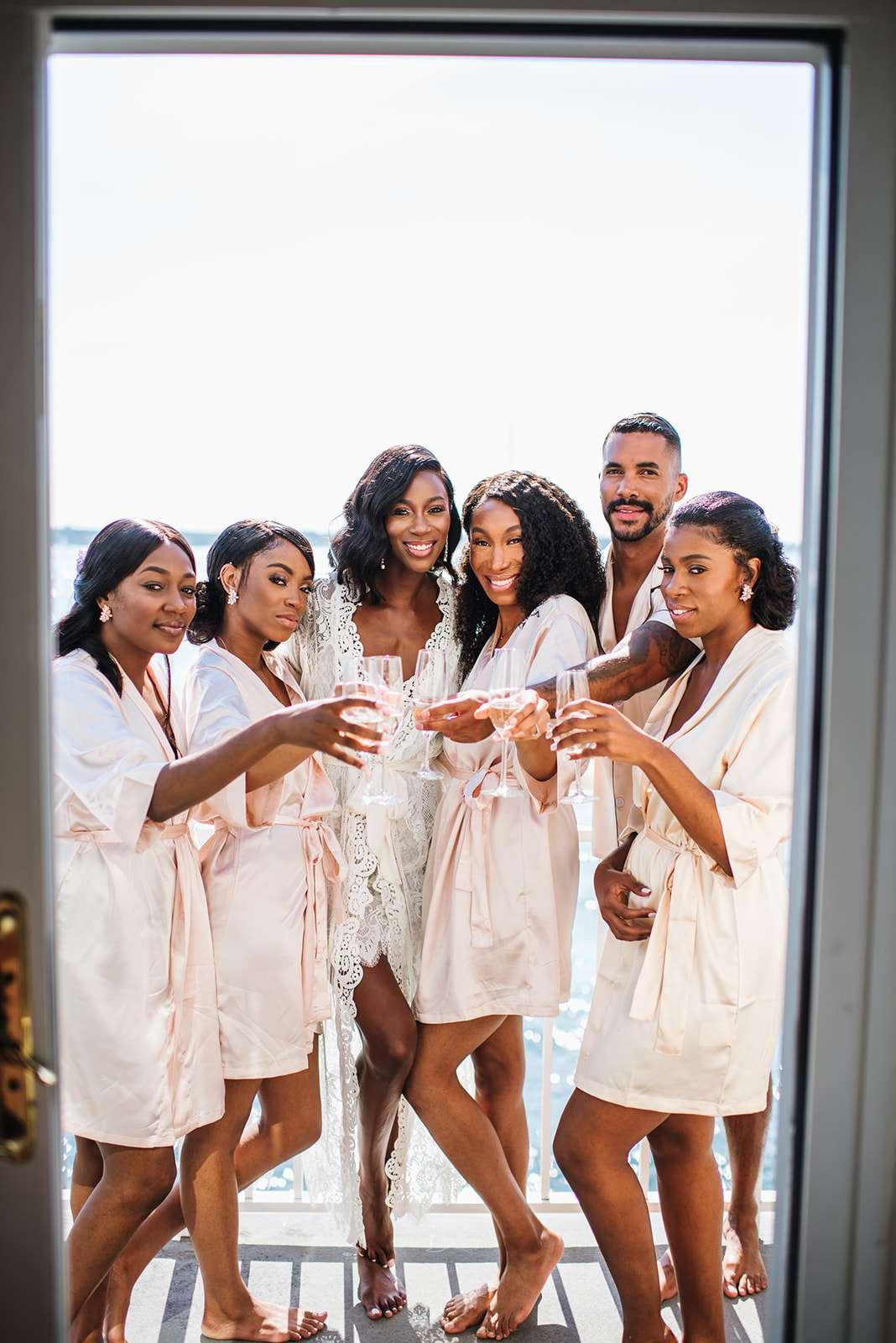 Bride, bridesmaids and bridesman on the balcony