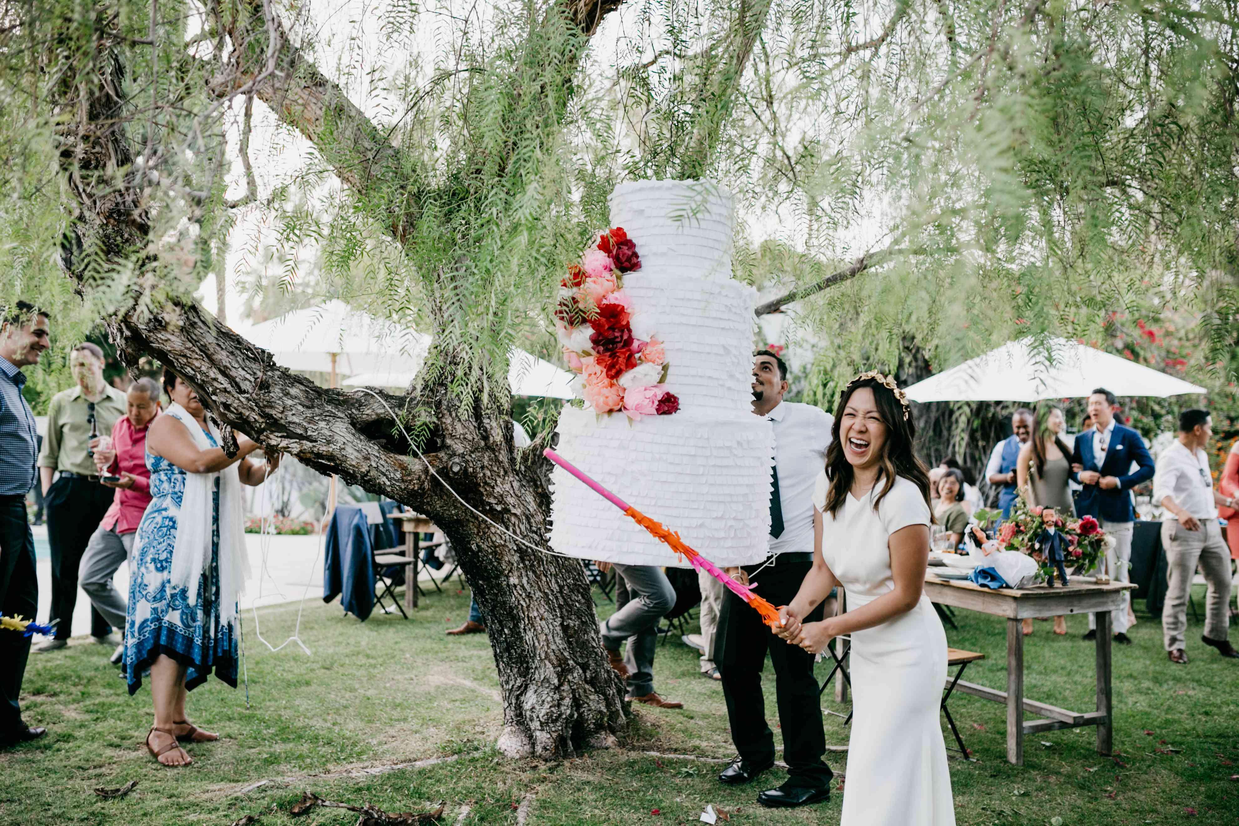 bride swinging at pinata