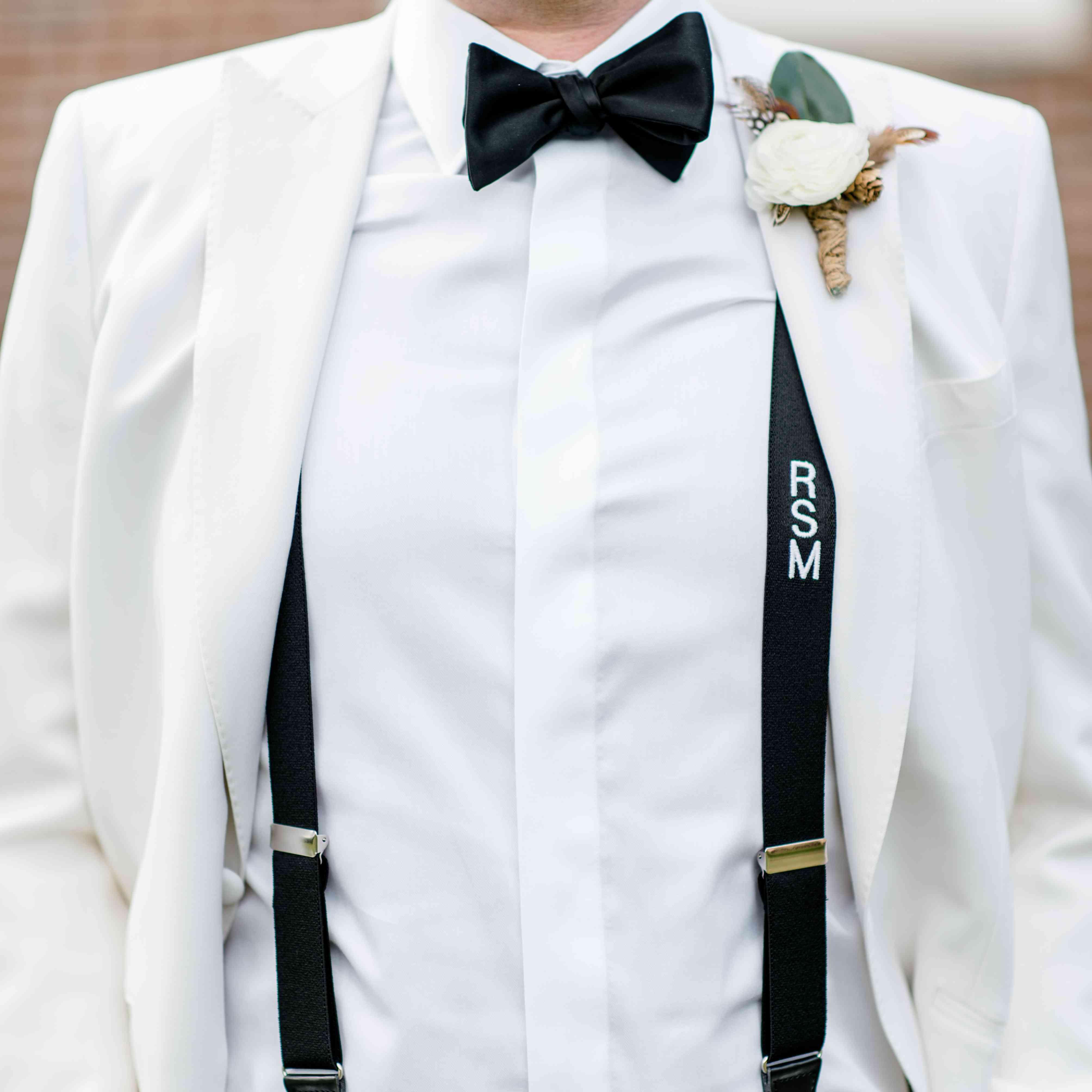 Groom in Tux with Suspenders