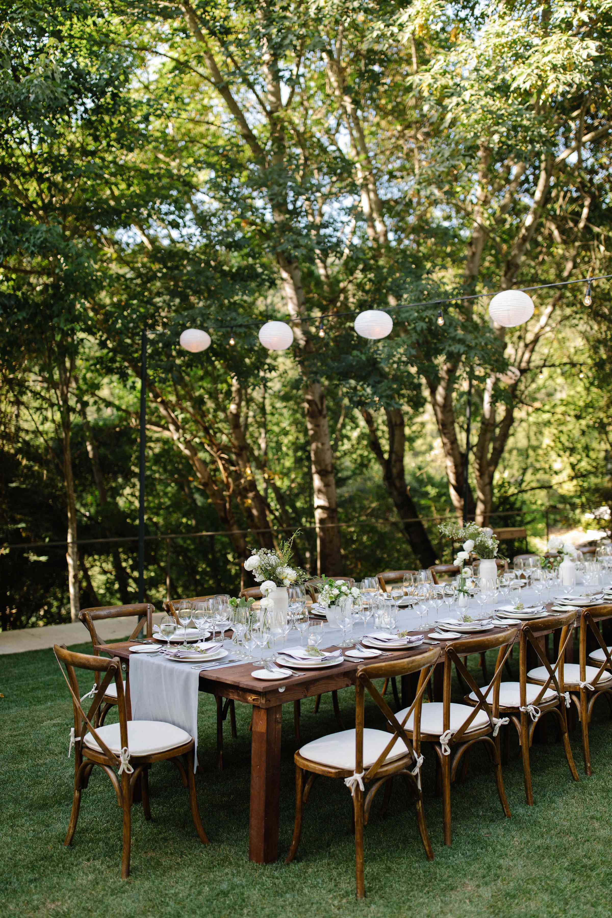<p>wood reception tables and lanterns</p><br><br>