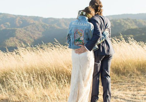 Bride in jean jacket with groom