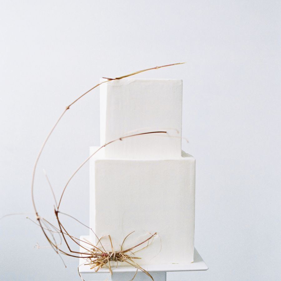 square cake with greenery