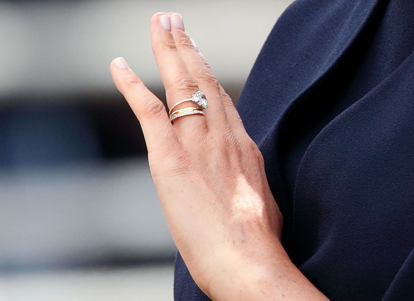 Meghan Markle's hand debuting reset engagement ring and new eternity band