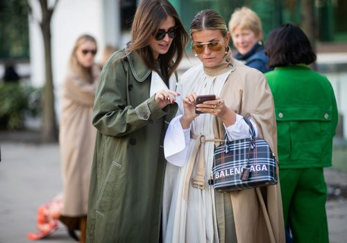 Women looking at a cellphone with her friend