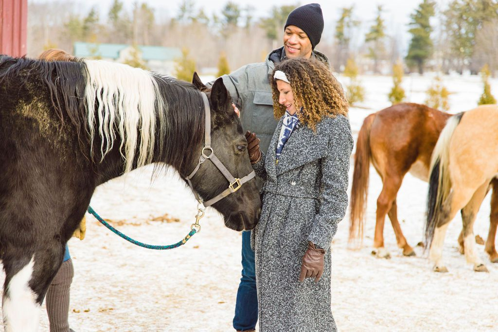 A couple petting a horse at Miraval Berkshires