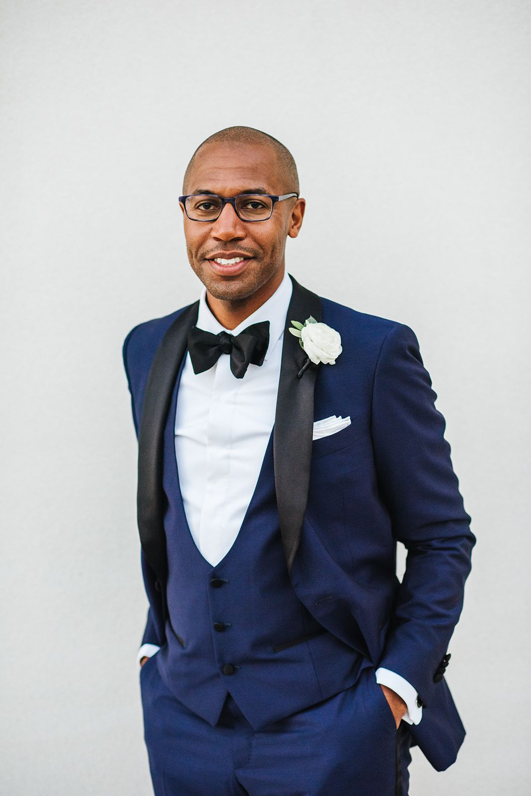Groom in indigo tux with black accents