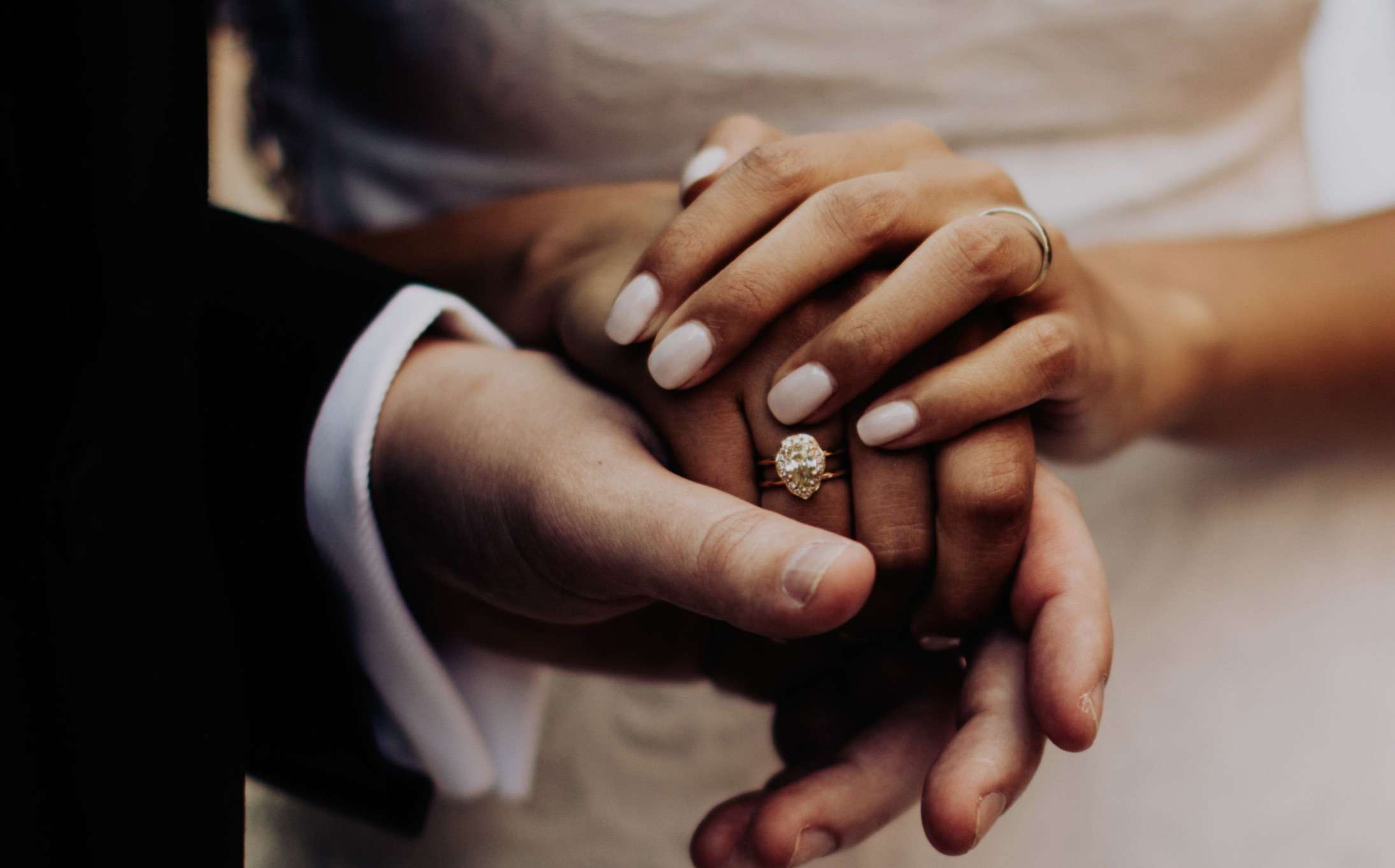 Bride with milky white manicure and pear shaped ring