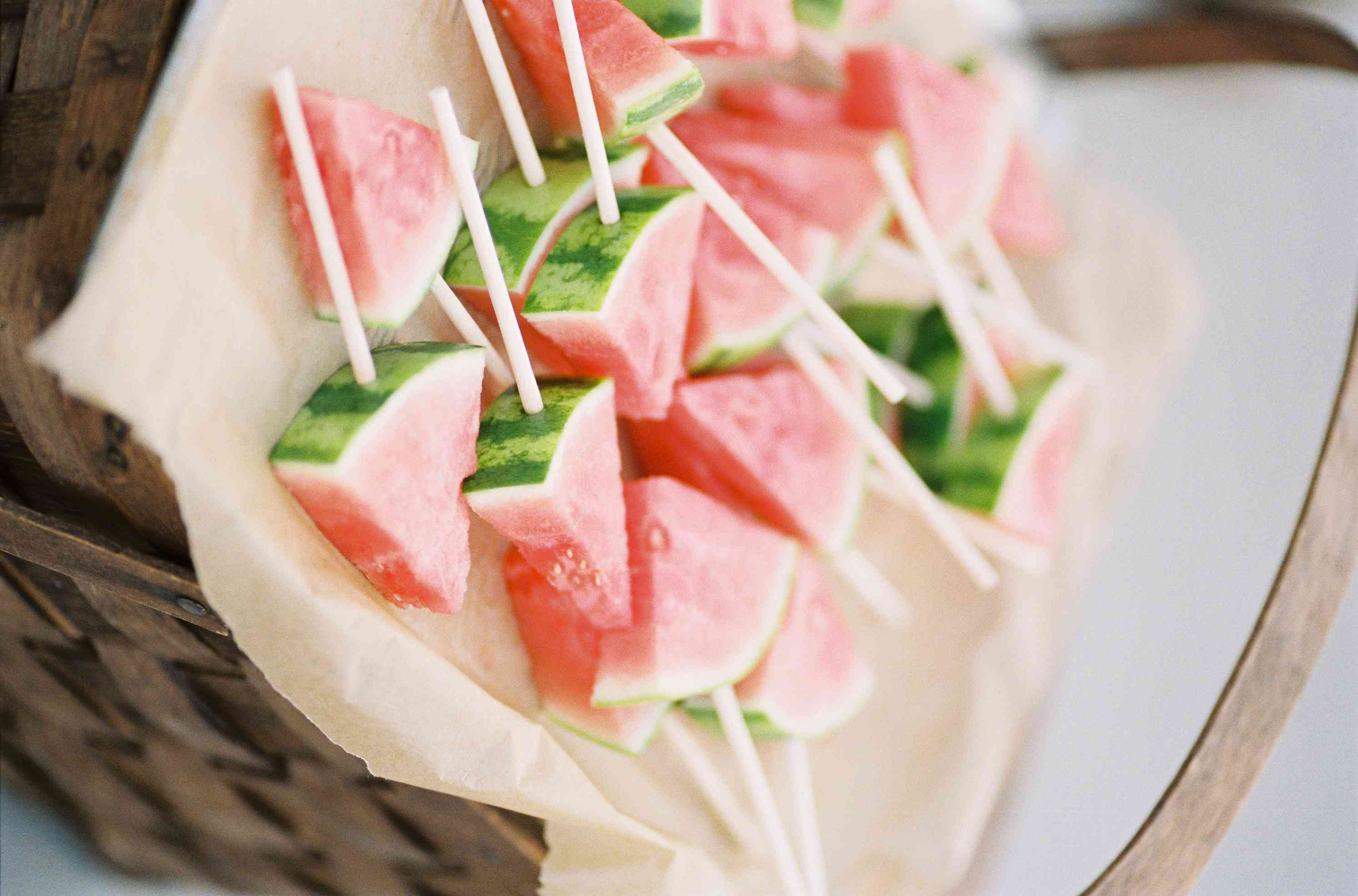 Basket with watermelon slices on skewers