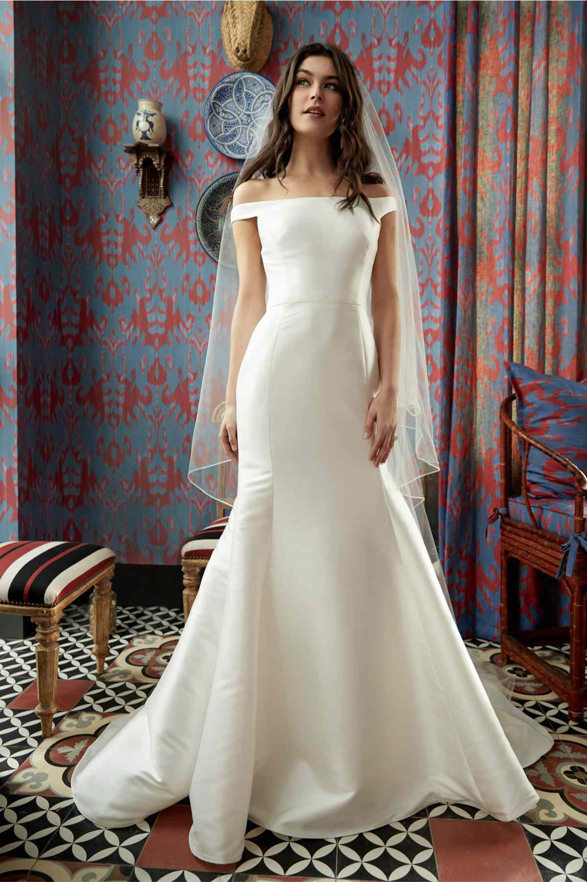 Model in off-the-shoulder mikado fit-and-flare gown