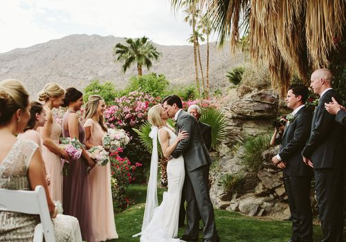 bride and groom kissing at outdoor ceremony