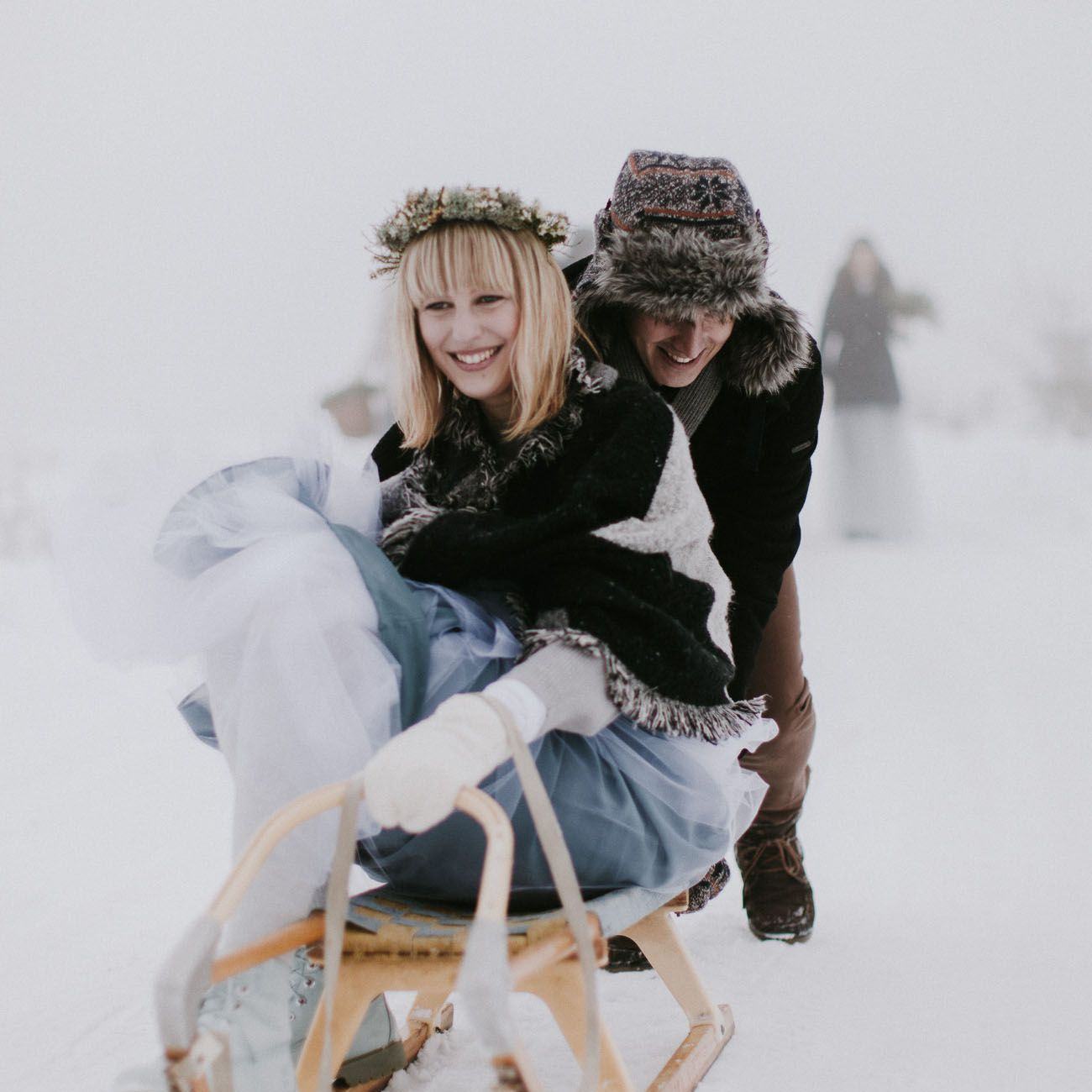 Bride and groom sledding