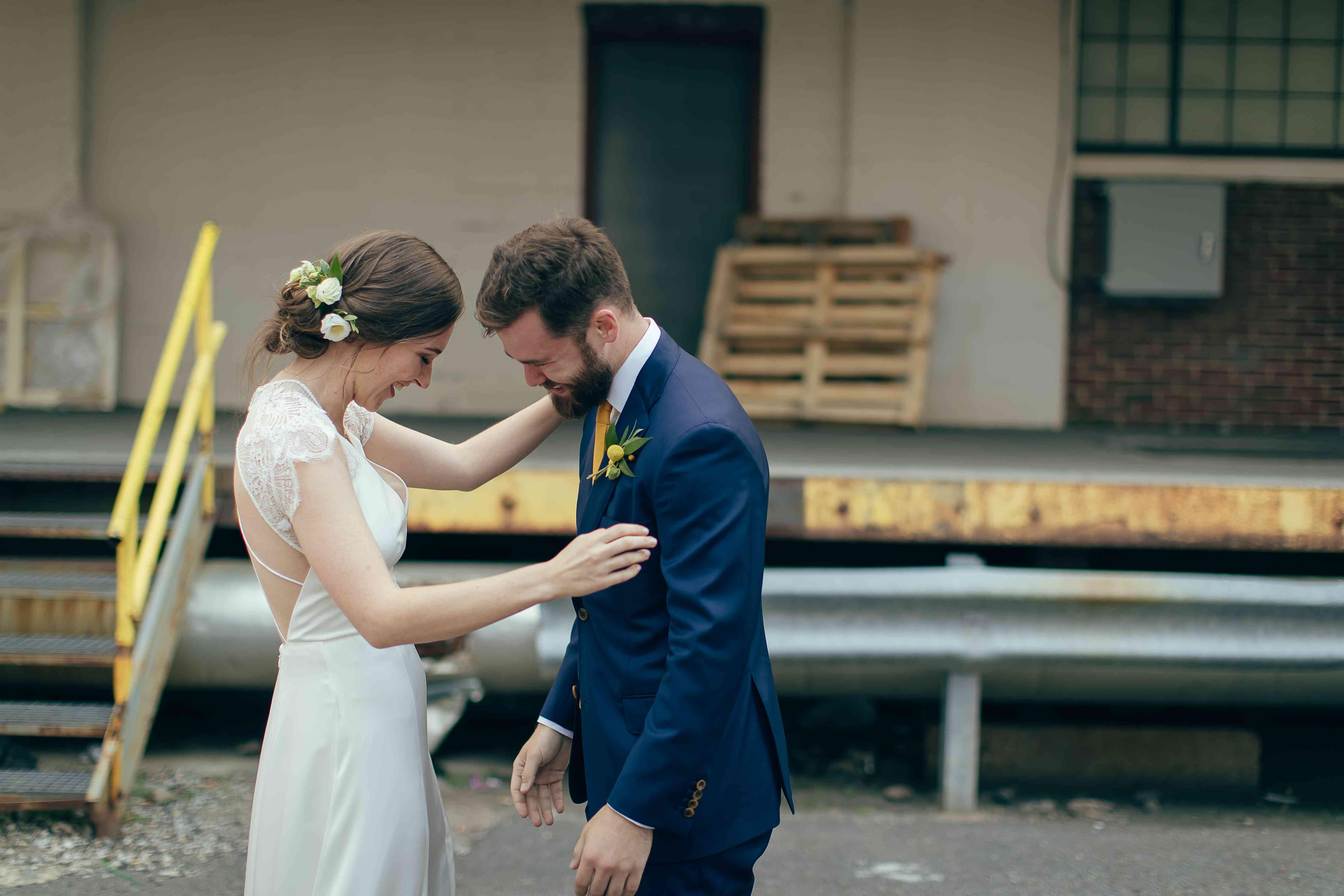 Bride and groom first look hugging