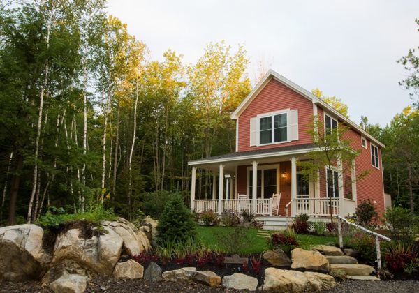 Red house in wooded area in Maine