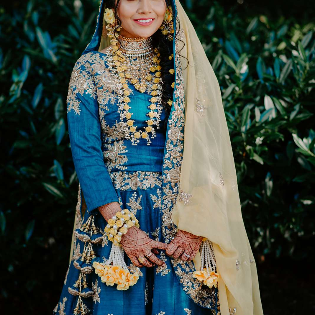 custom lehenga in bold blue with gold floral embroidery