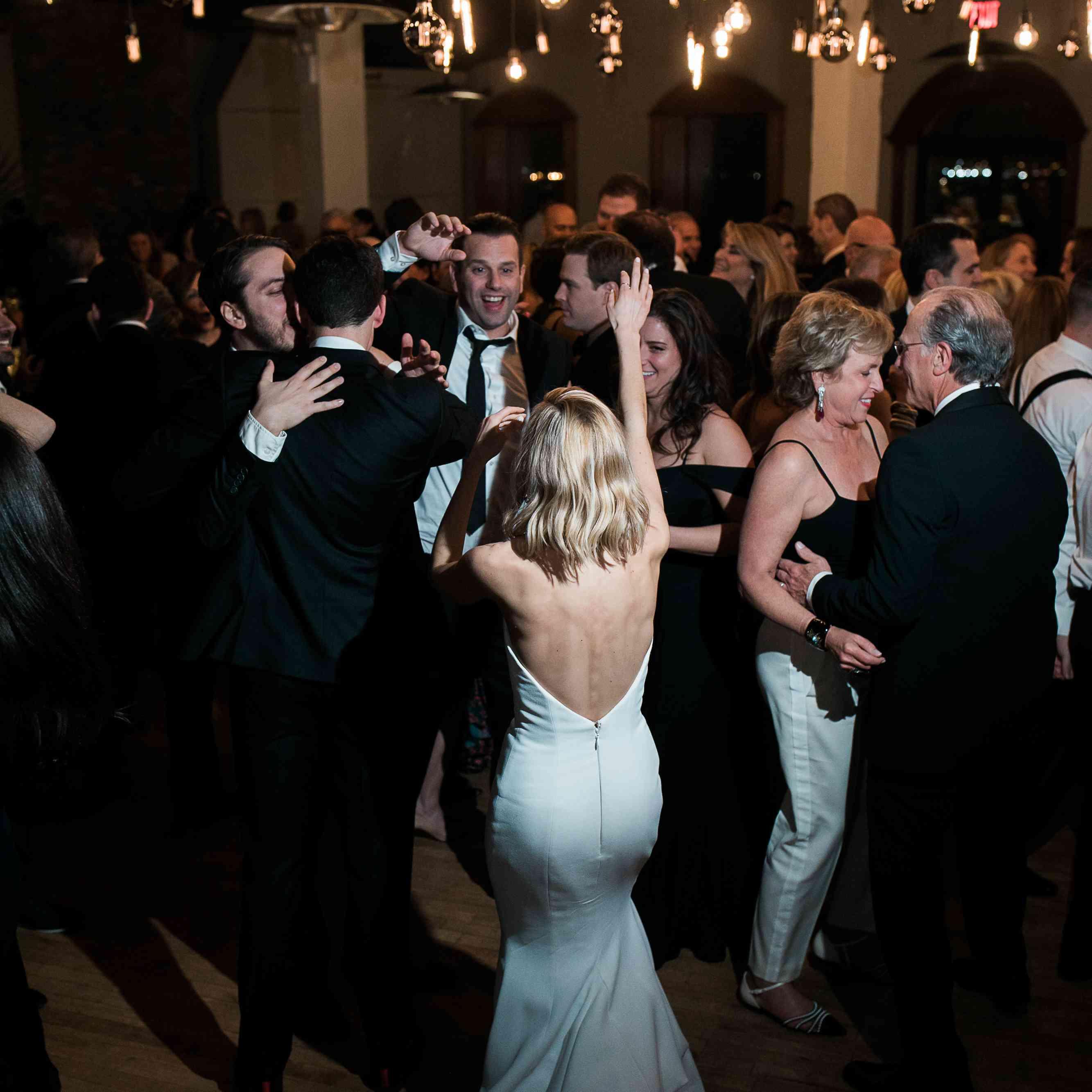 Bride and groom dancing reception