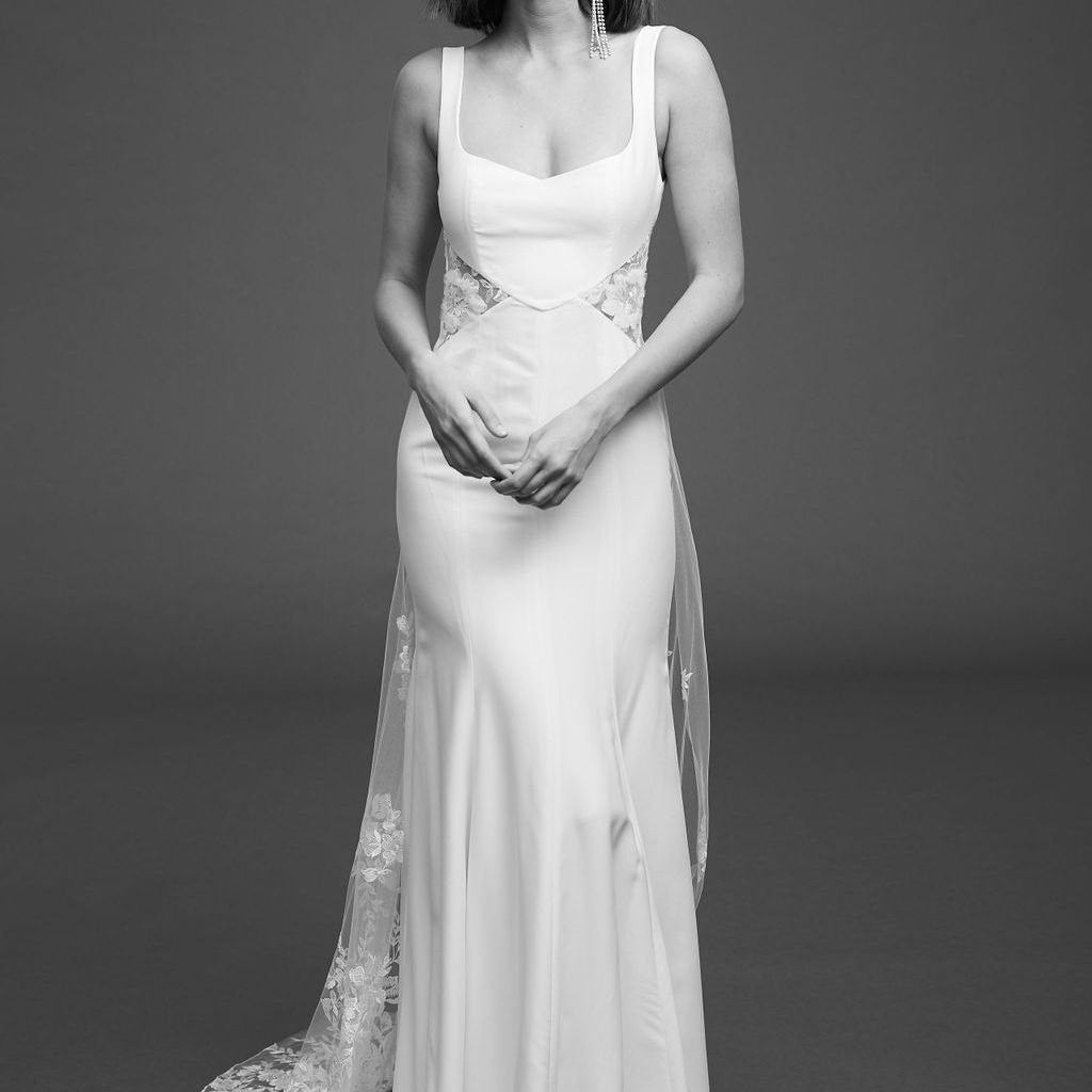 Model in sleeveless crepe dress with embroidered tulle side cutouts