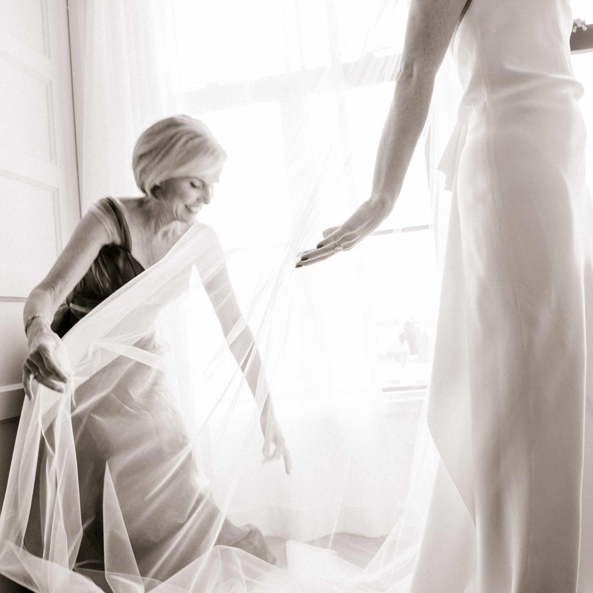 mother fixing bridal veil
