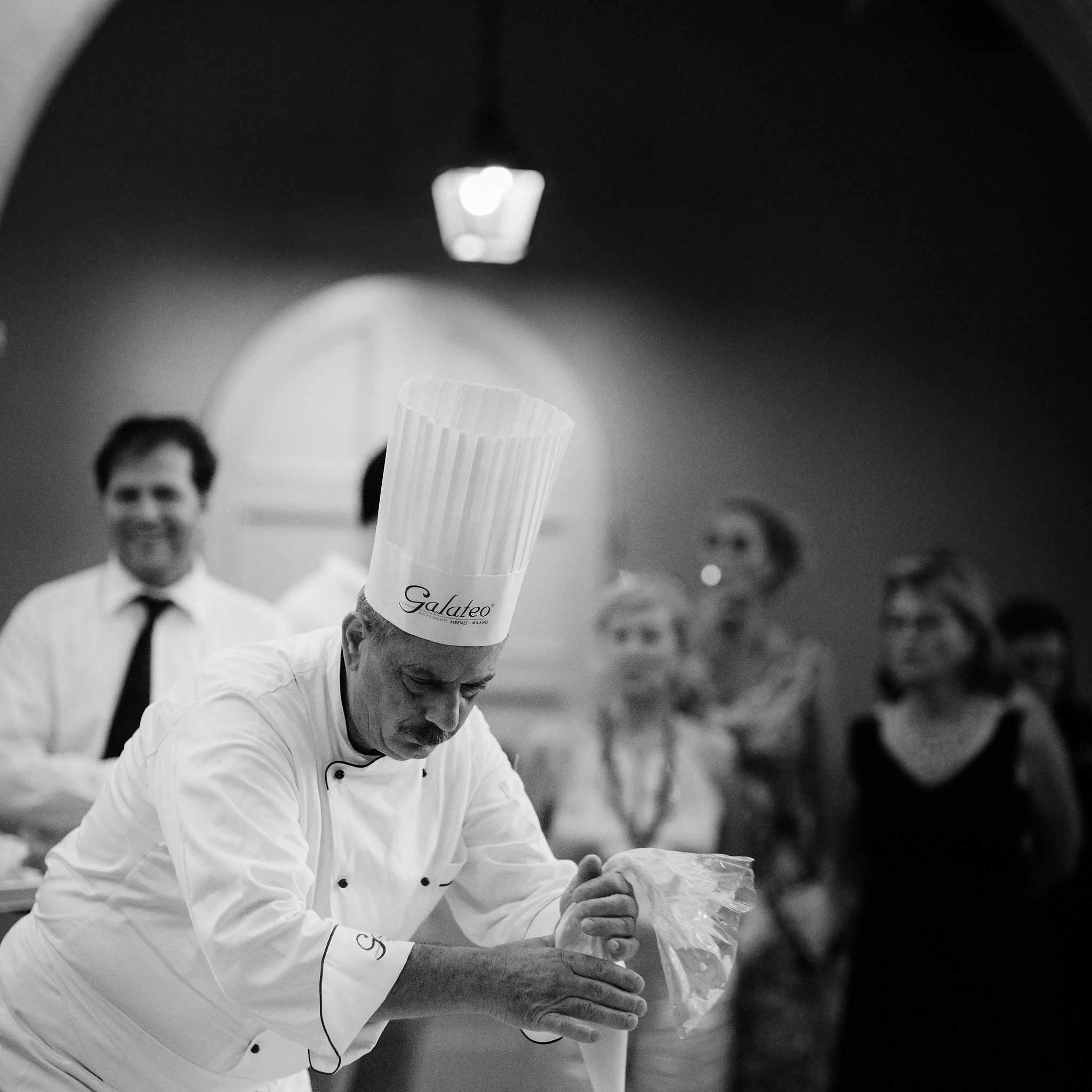 Chef making wedding cake