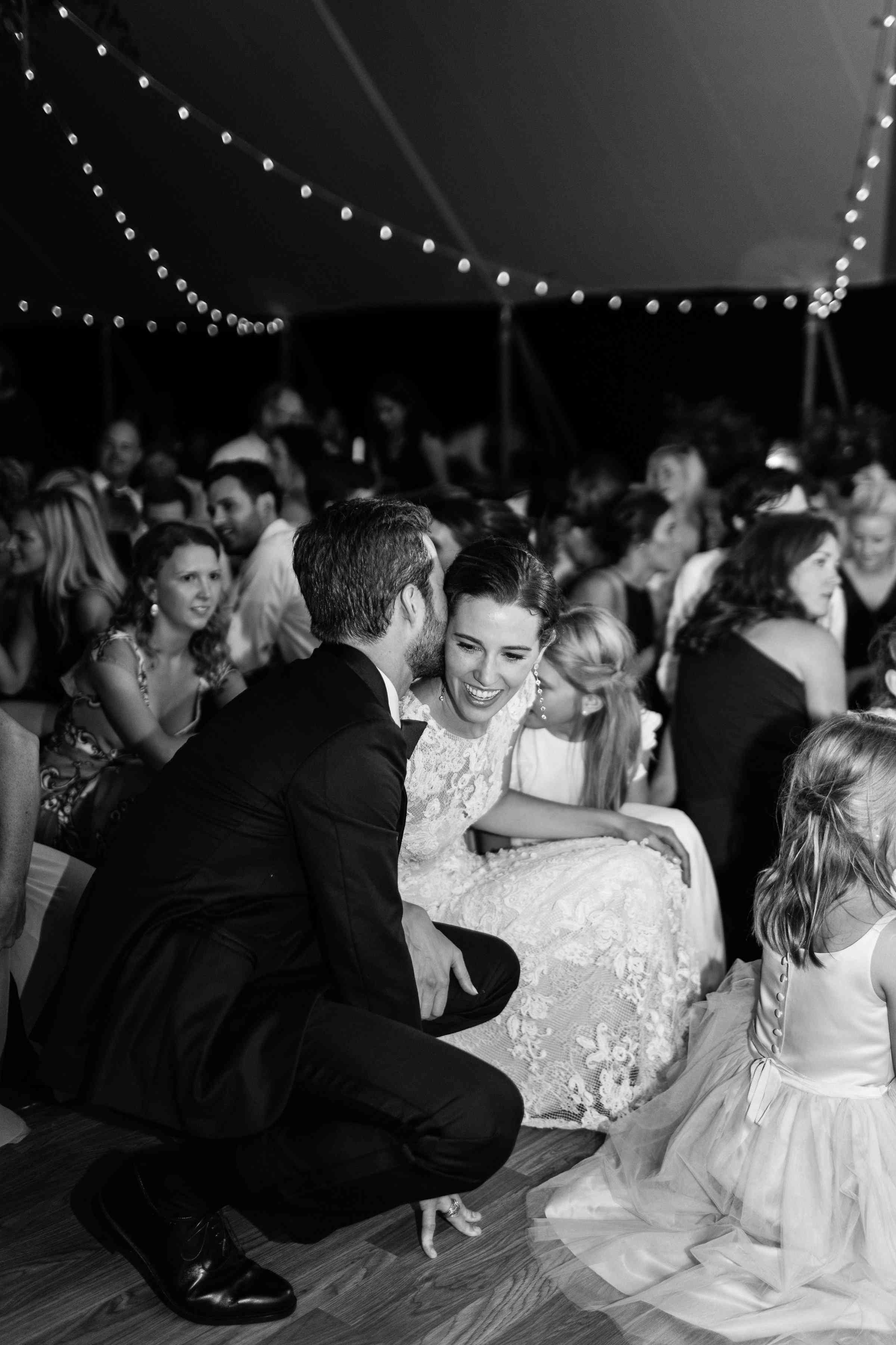 <p>Bride and groom whispering</p><br><br>