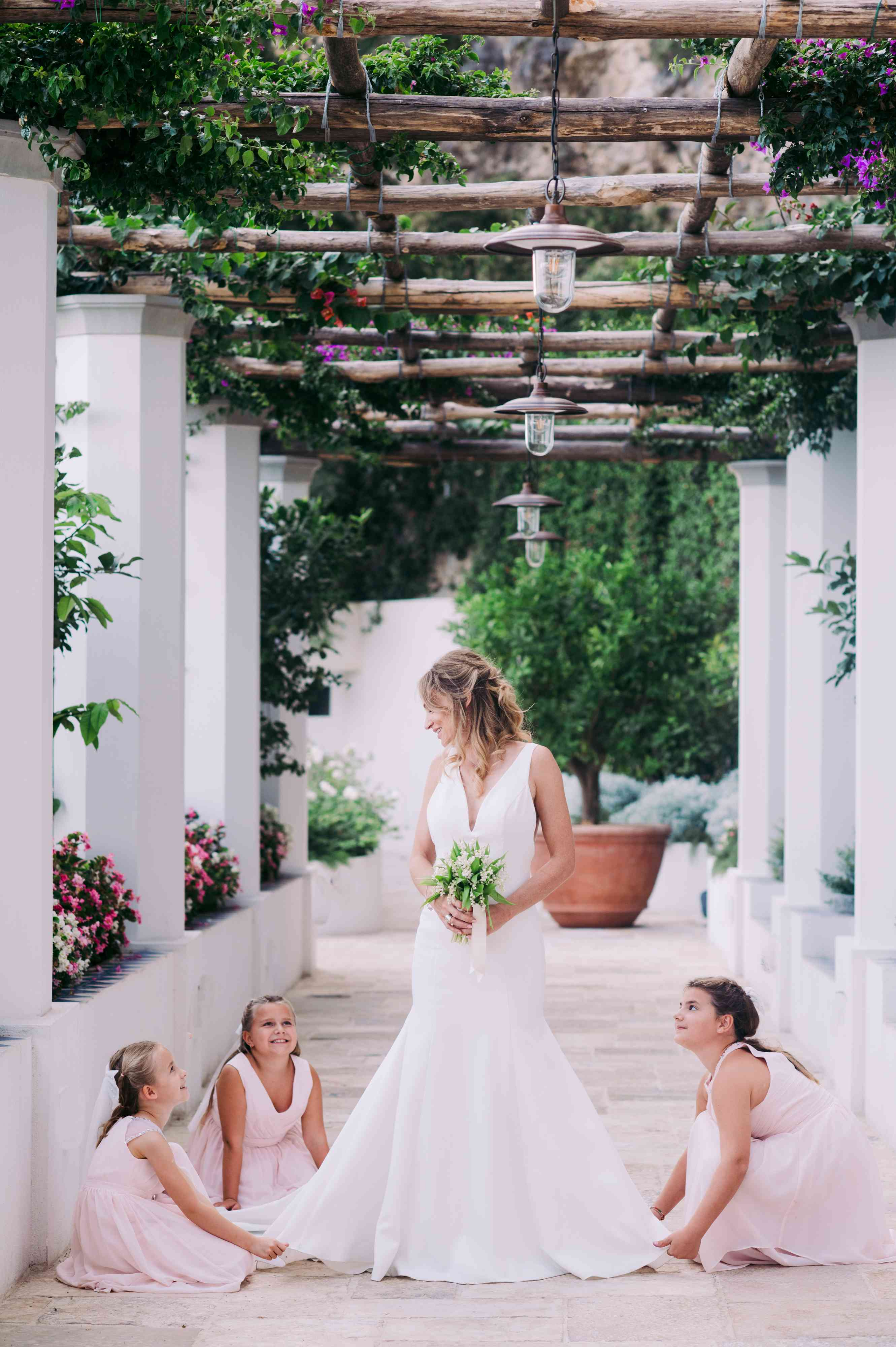 Flower girls holding dress