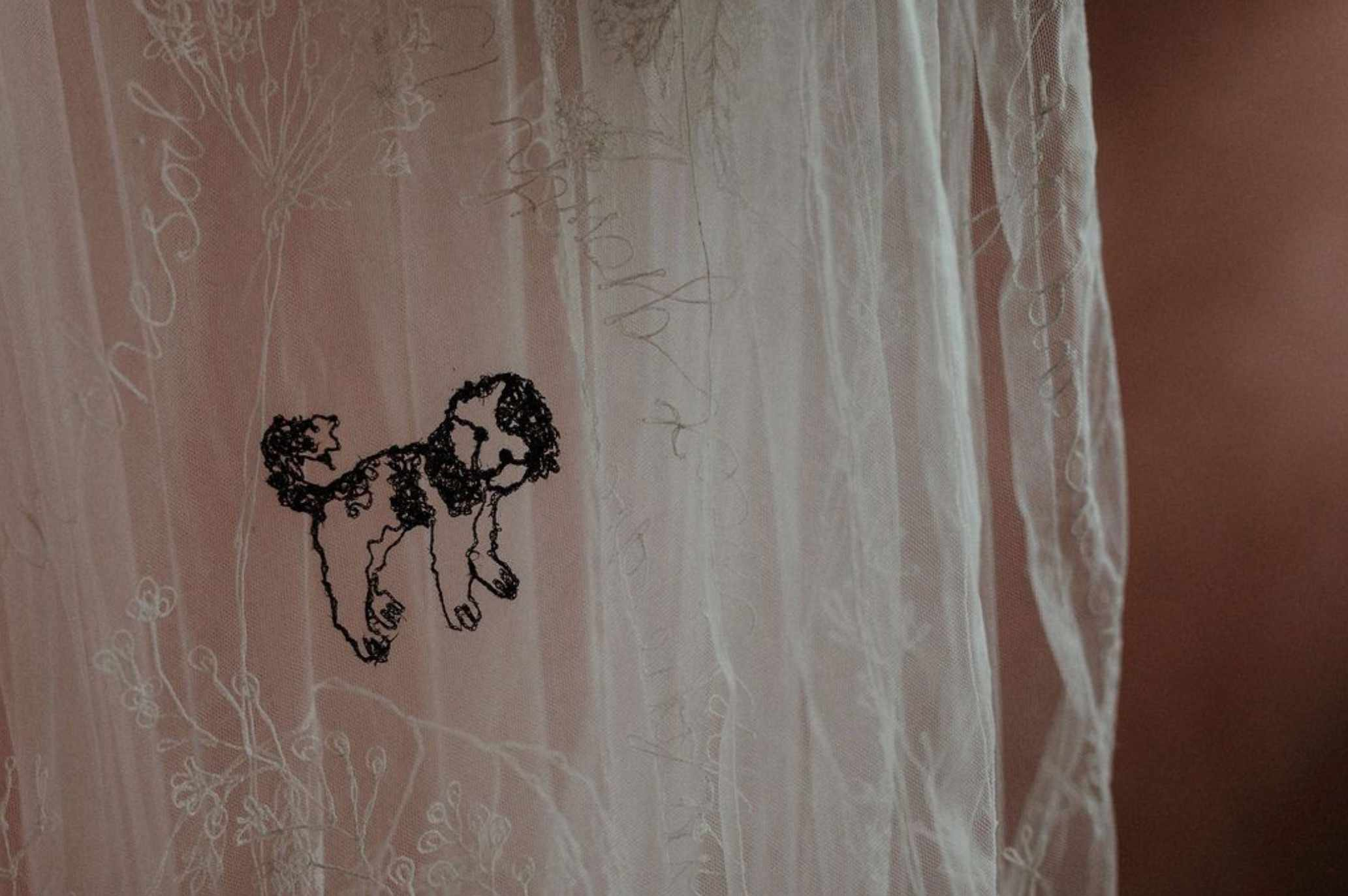 Dog embroidery on veil