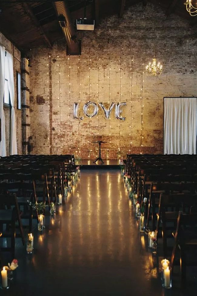 String lights and mylar balloons for a simple, yet striking ceremony backdrop