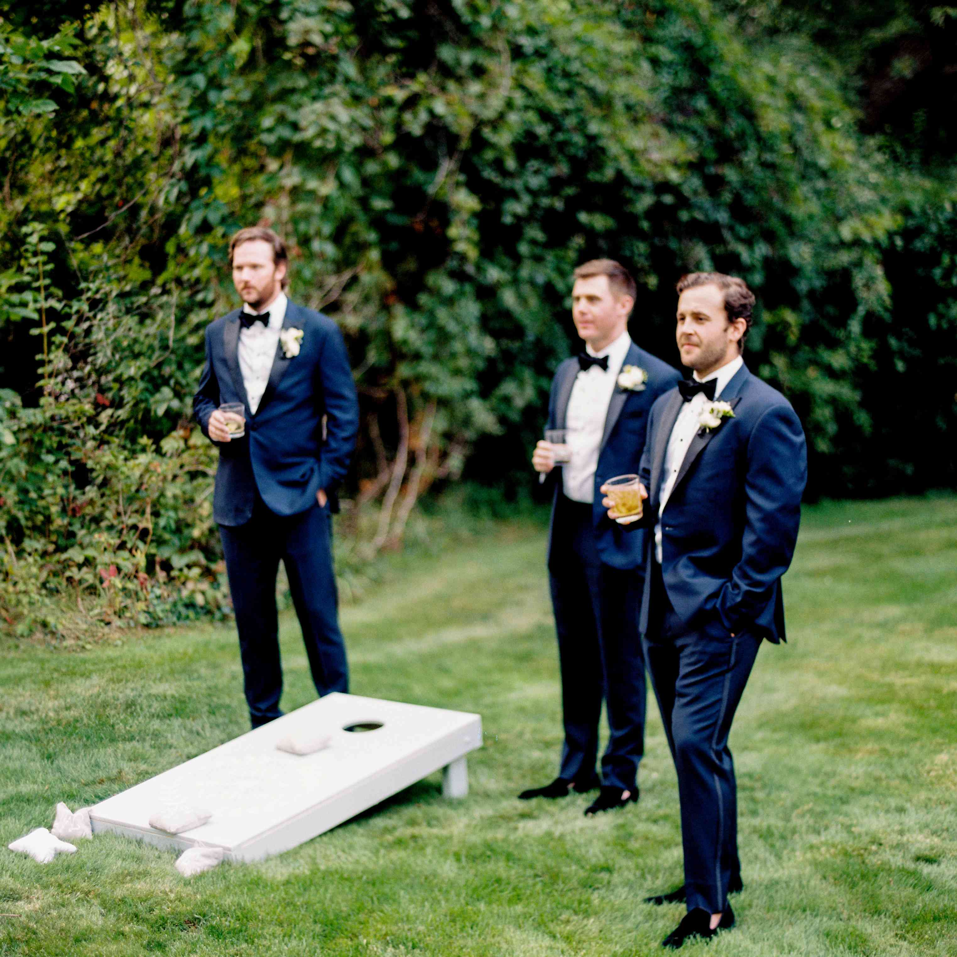 groomsman navy suits playing reception games