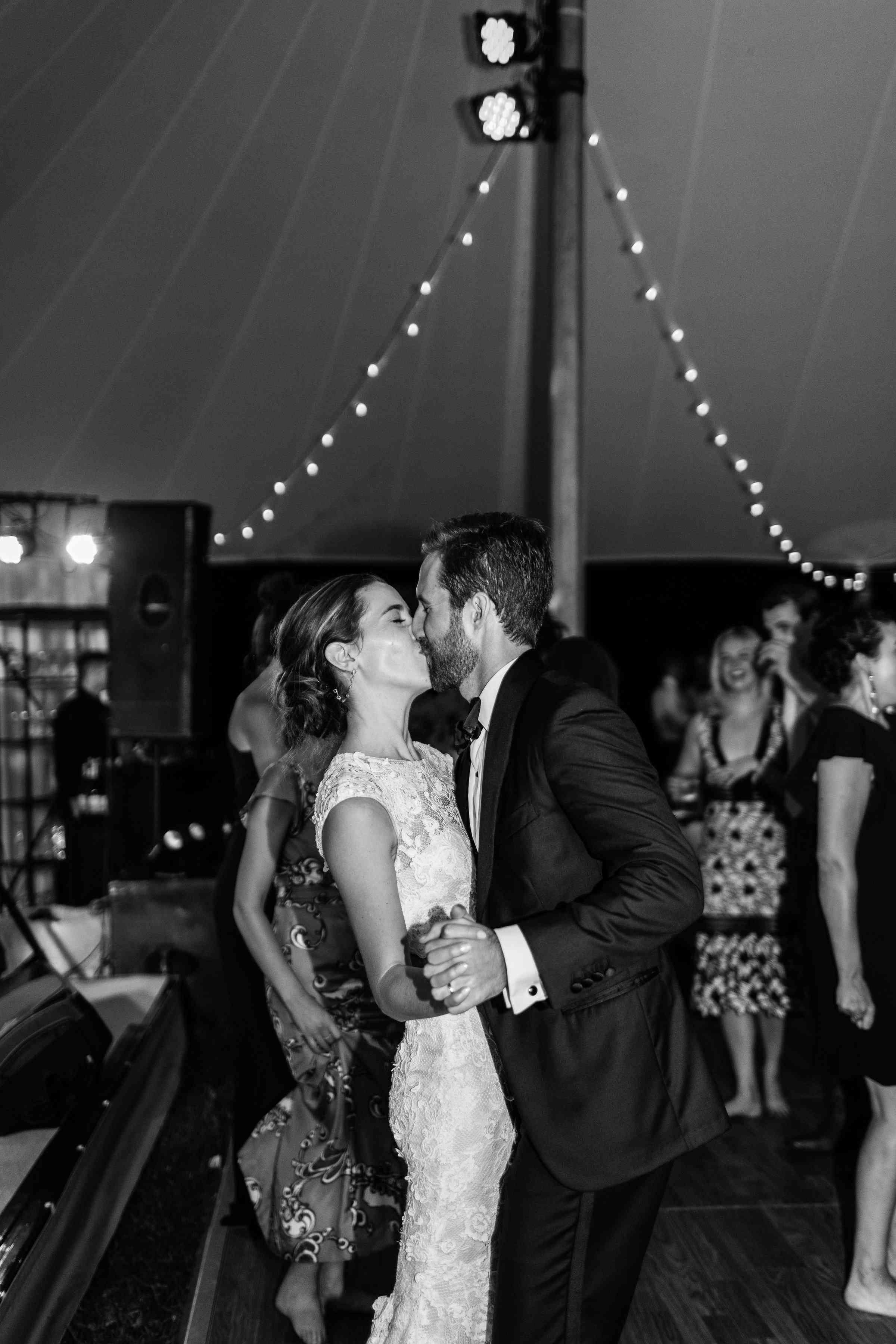 <p>Bride and Groom kissing during dance</p><br><br>