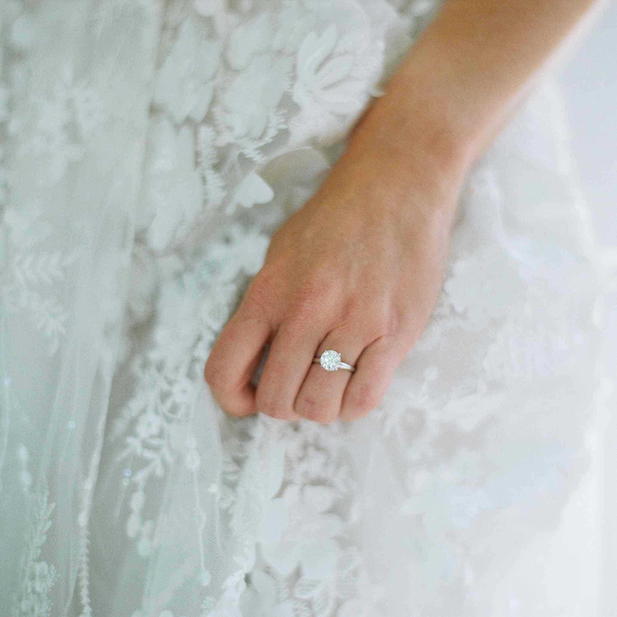 Bride wearing round-cut engagement ring