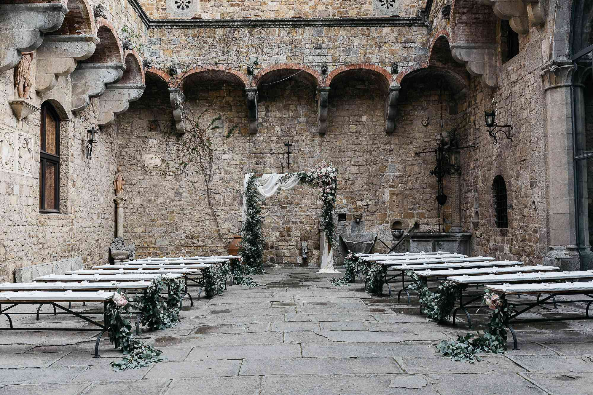 Wedding ceremony in a castle courtyard