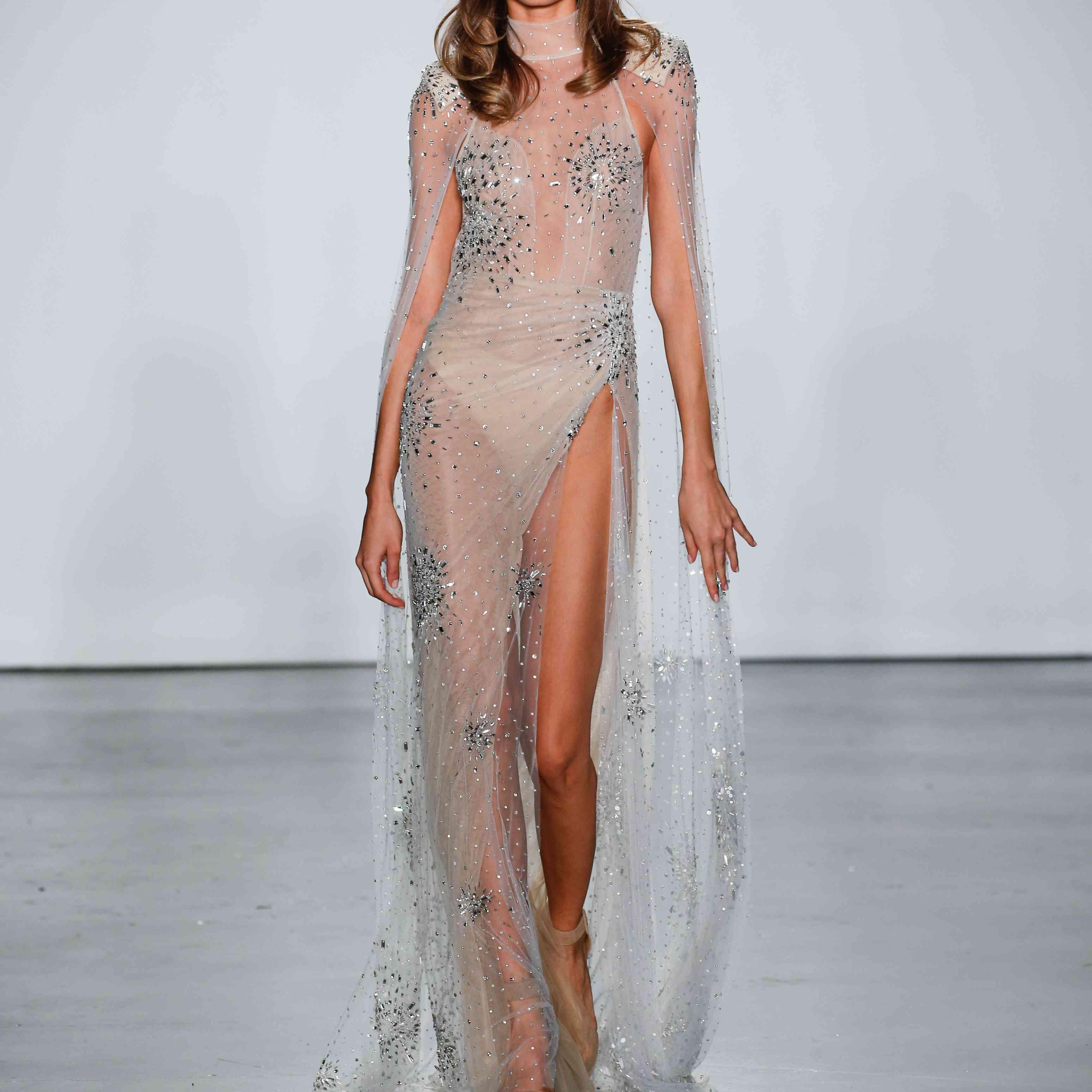 Model in tulle cape sheath wedding dress