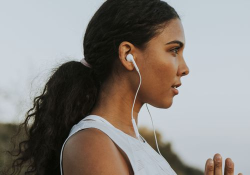woman being active outdoors with headphones on