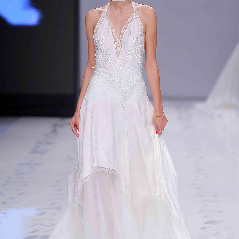 Model in lace and satin V-neck halter wedding dress