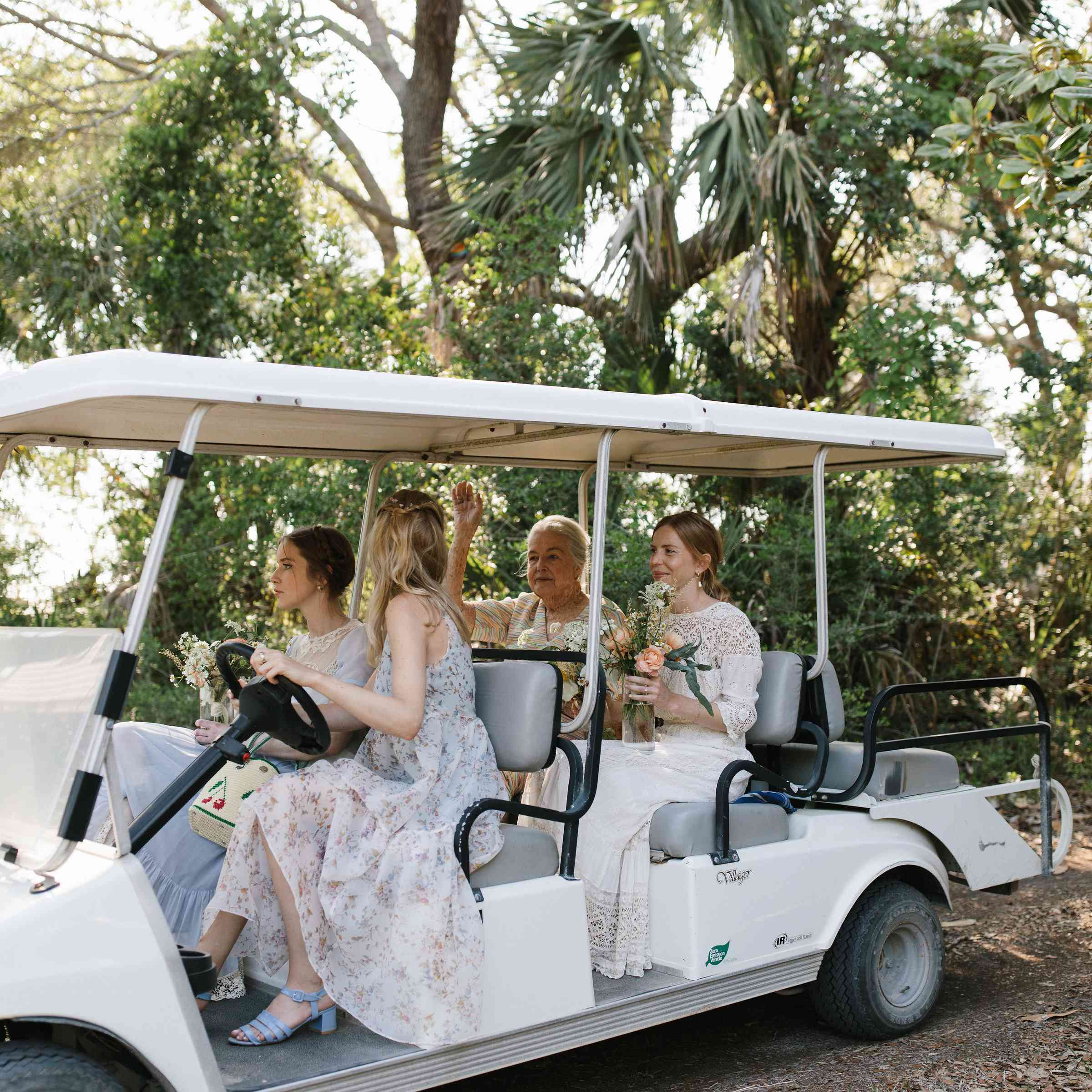 <p>bridal party in golf cart wedding transportation</p><br><br>