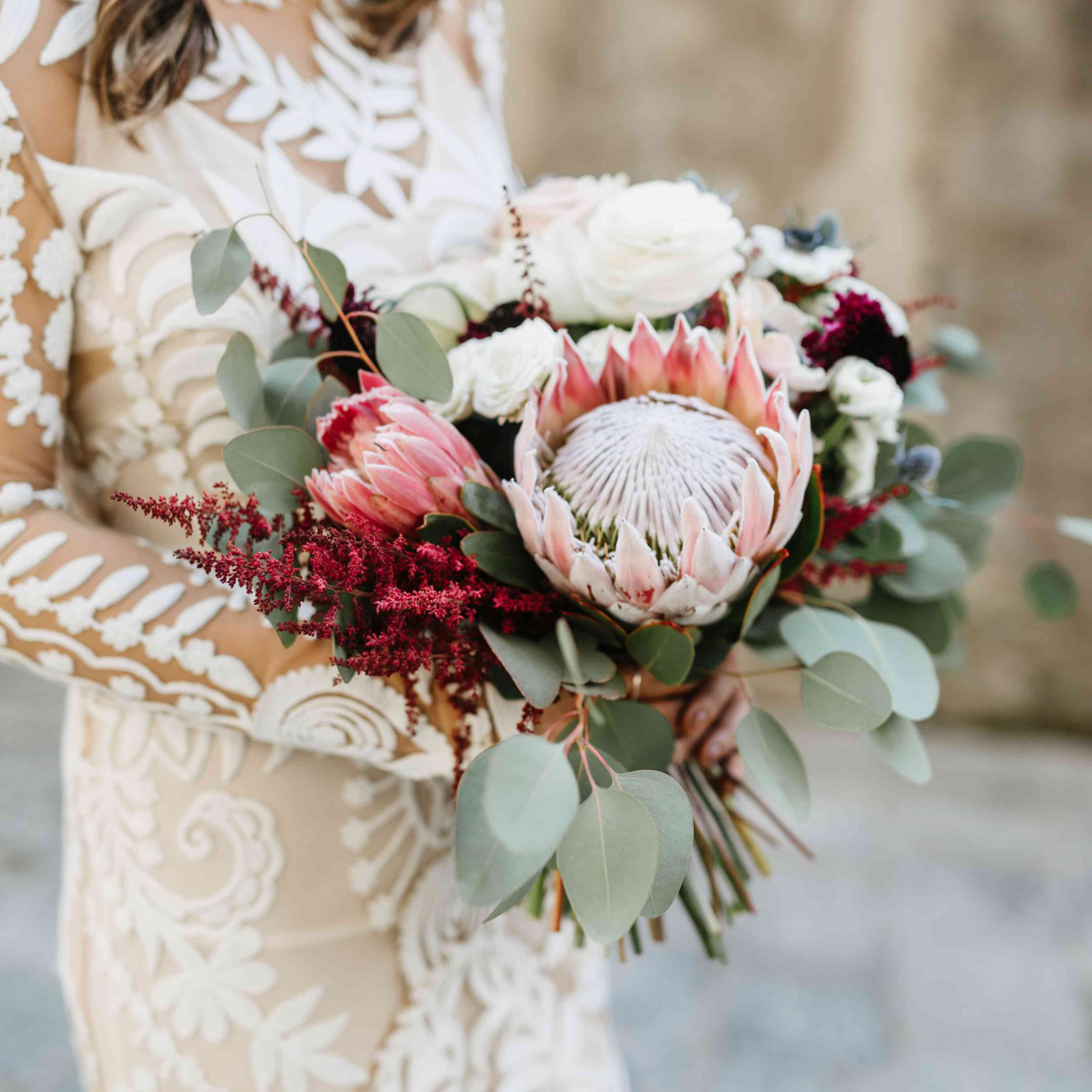 Bride's bouquet featuring King Protea front and center