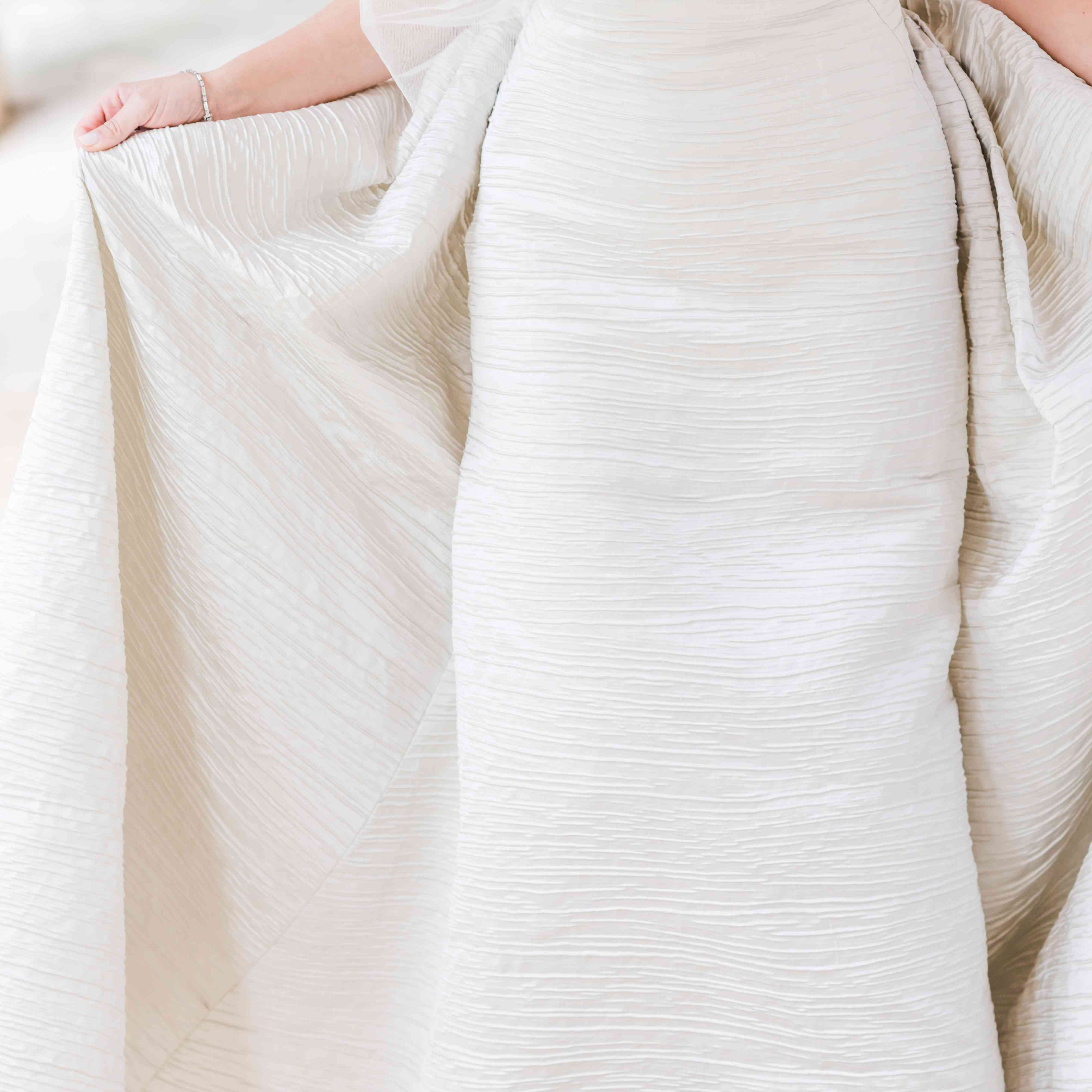<p>bride wedding dress skirt closeup</p><br><br>