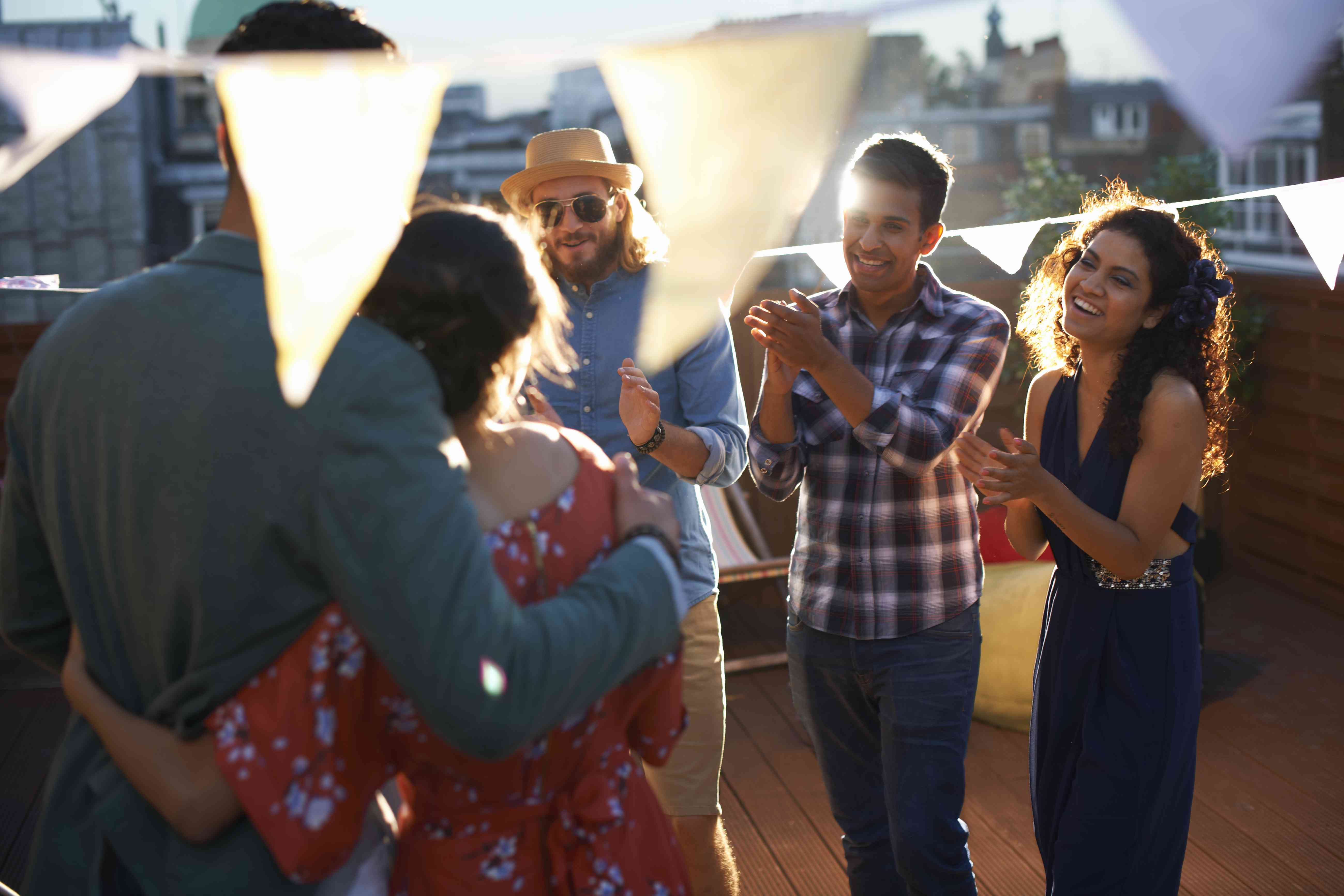 <p>couple surrounded by friends at engagement party</p>