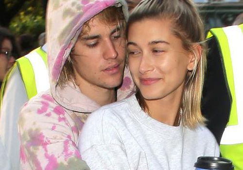Justin Bieber and Hailey Baldwin hug in London, England.