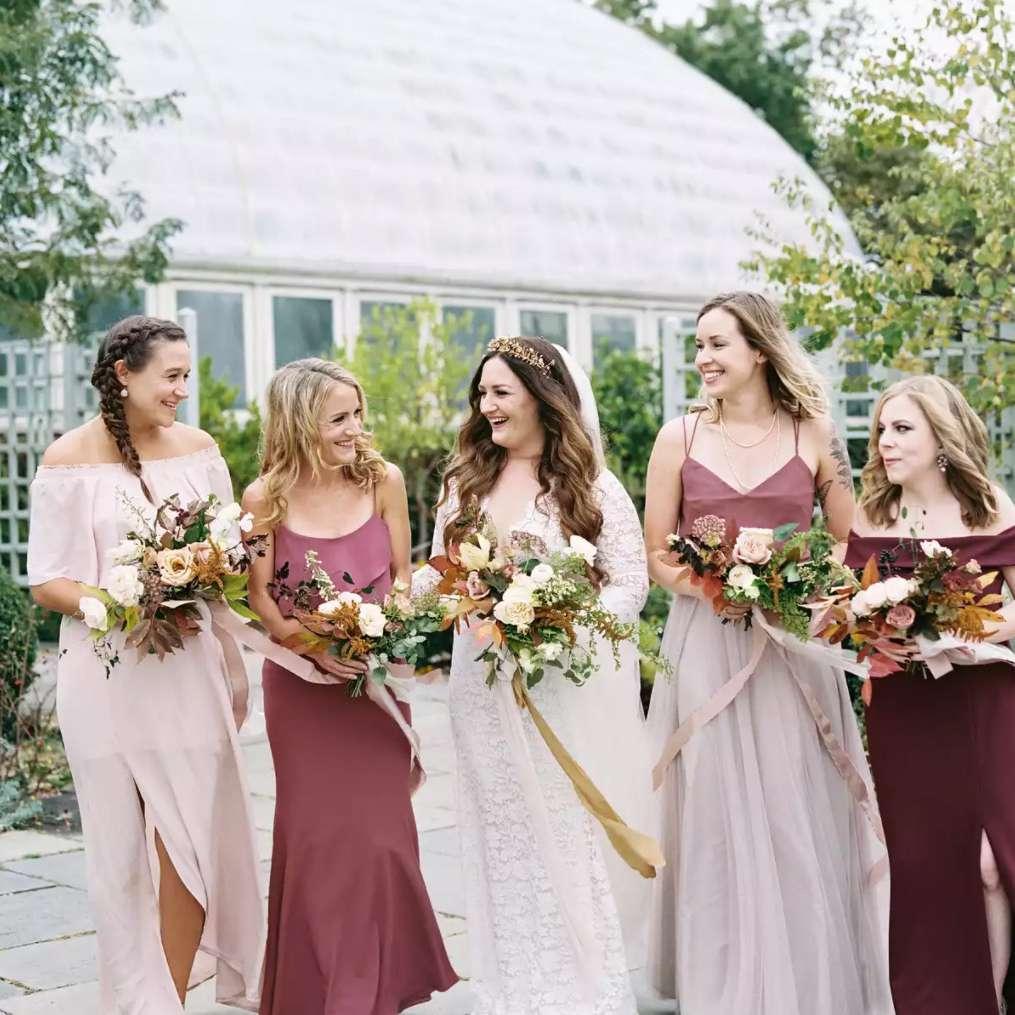Bride with bridesmaids in berry tones