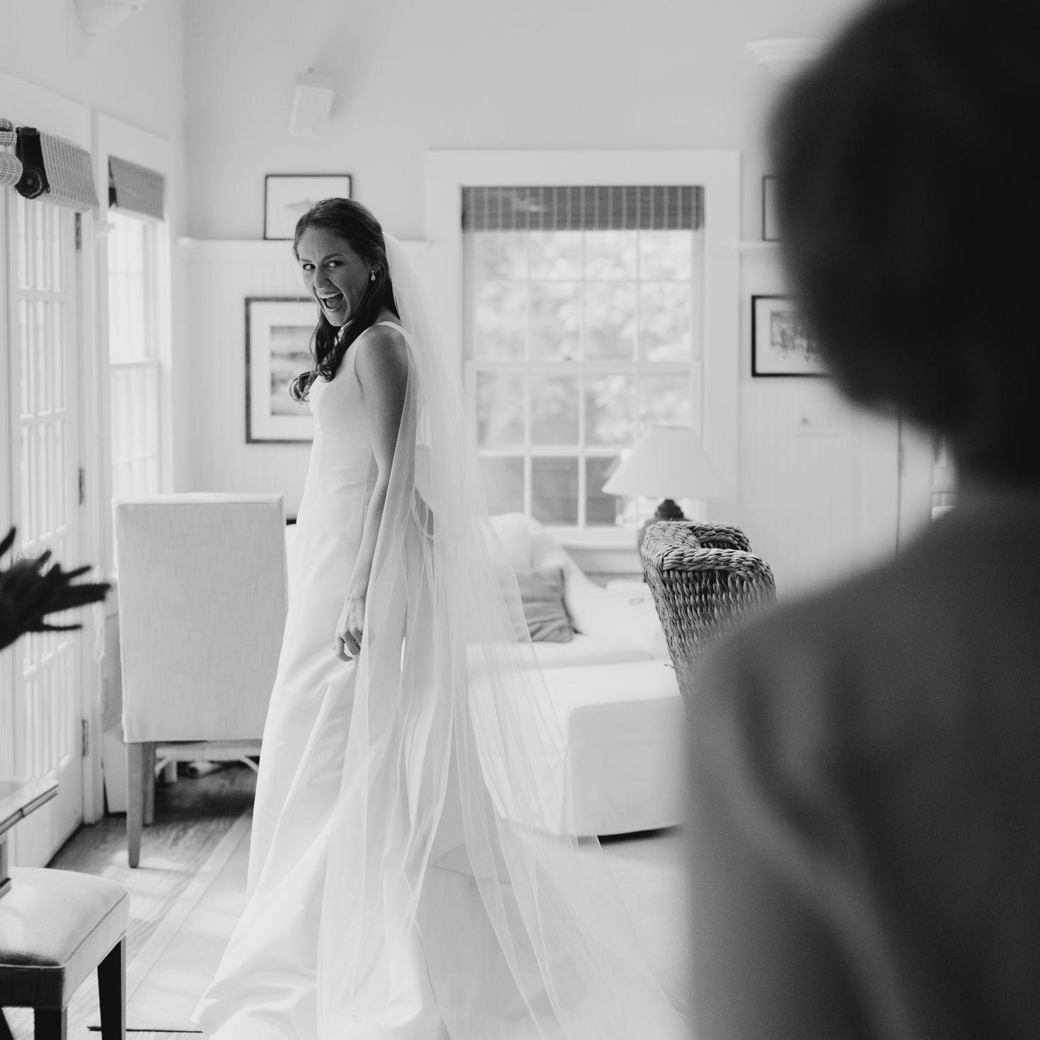 at-home rustic massachusetts wedding, bride posing in wedding dress