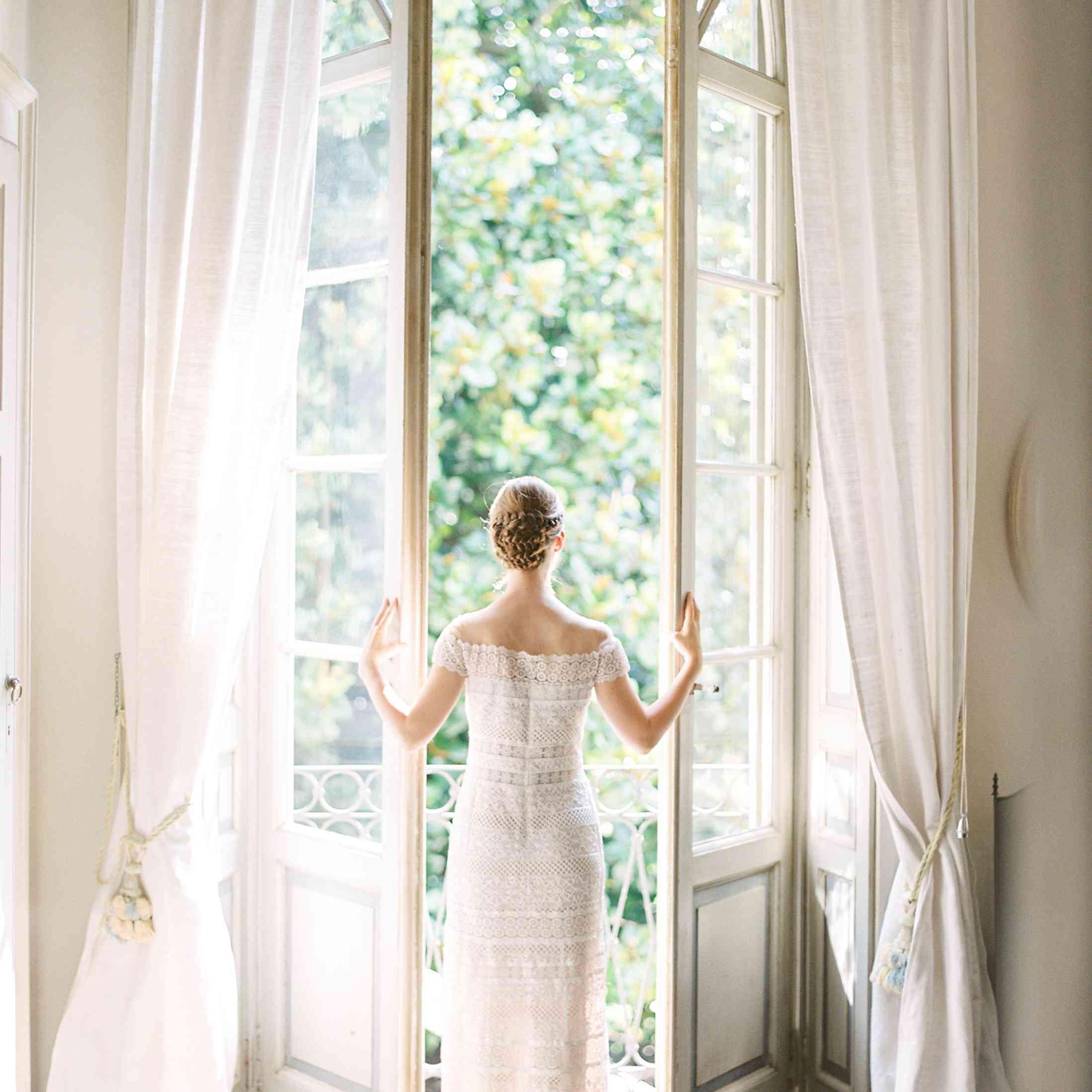 Bride looking through a window