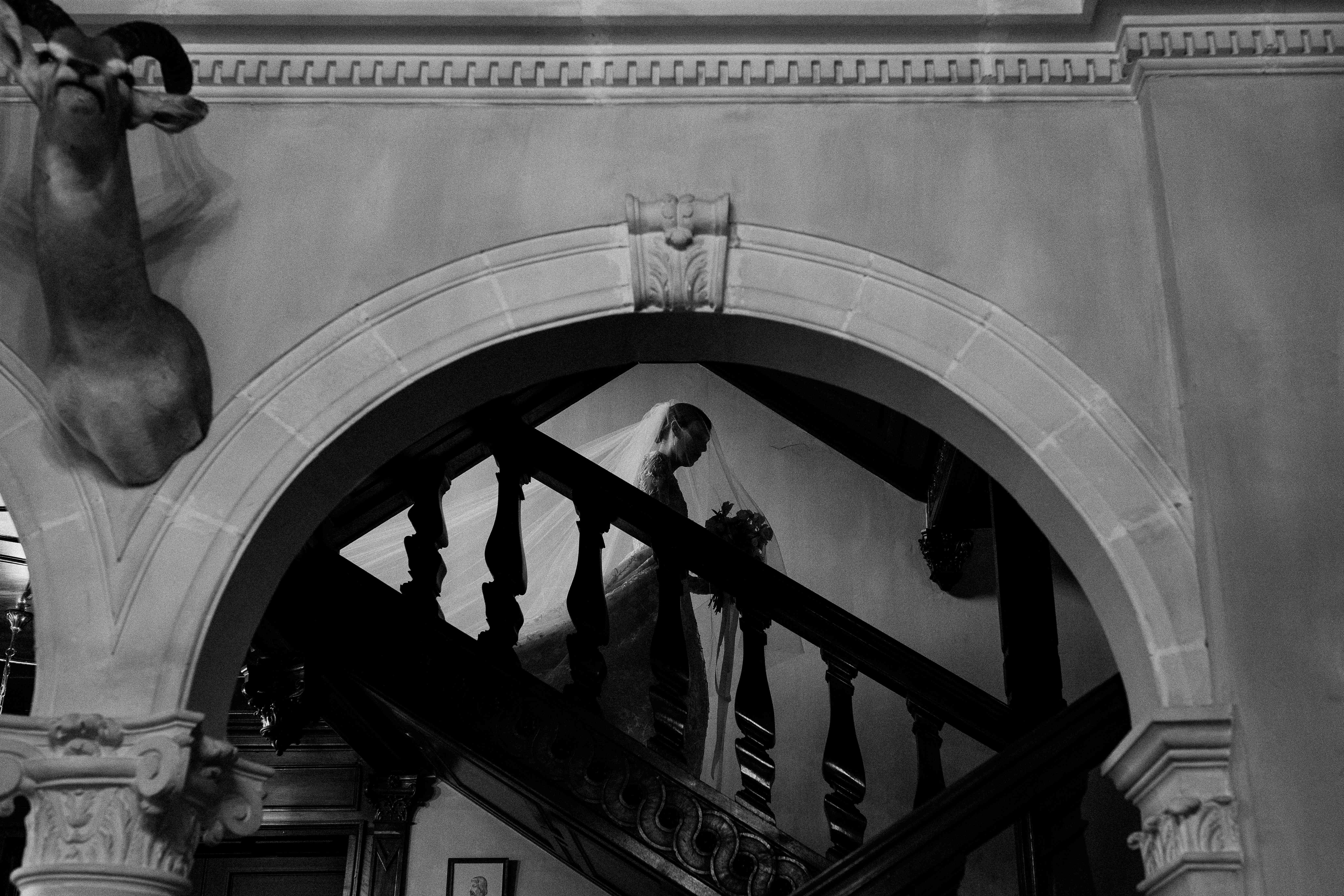 <p>bride walking down the stairs</p><br><br>