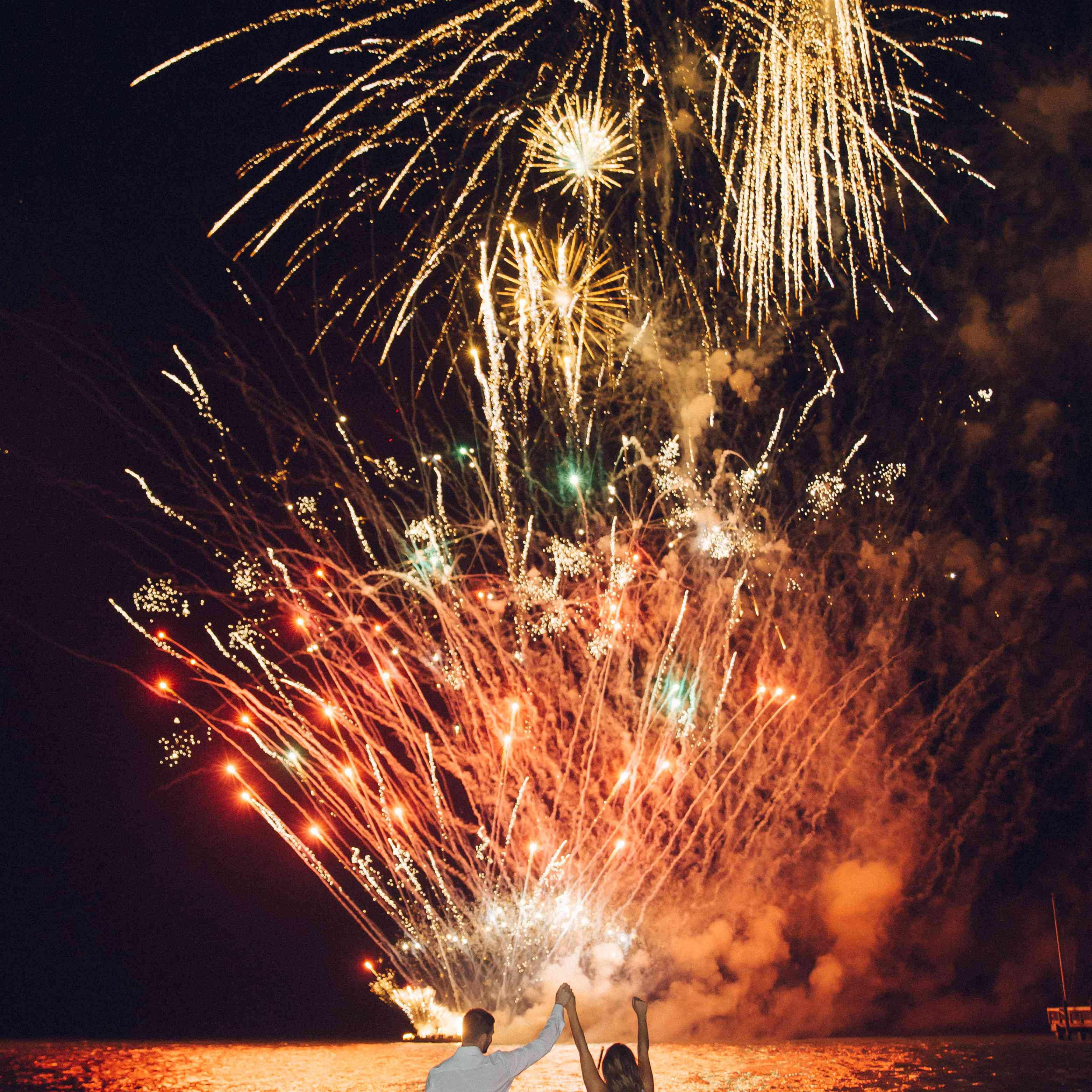 Bride and groom in front of fireworks