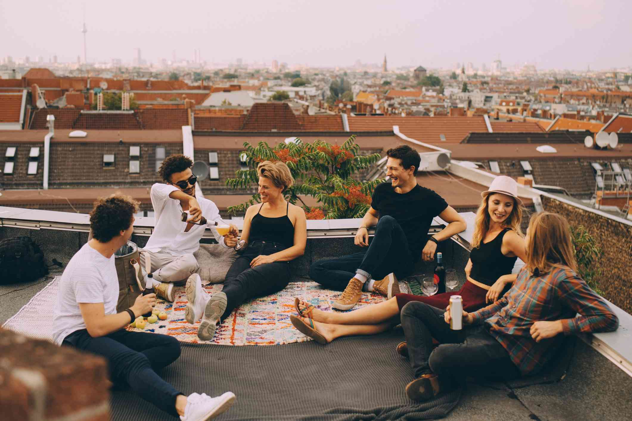 Group of friends hanging out on a roof