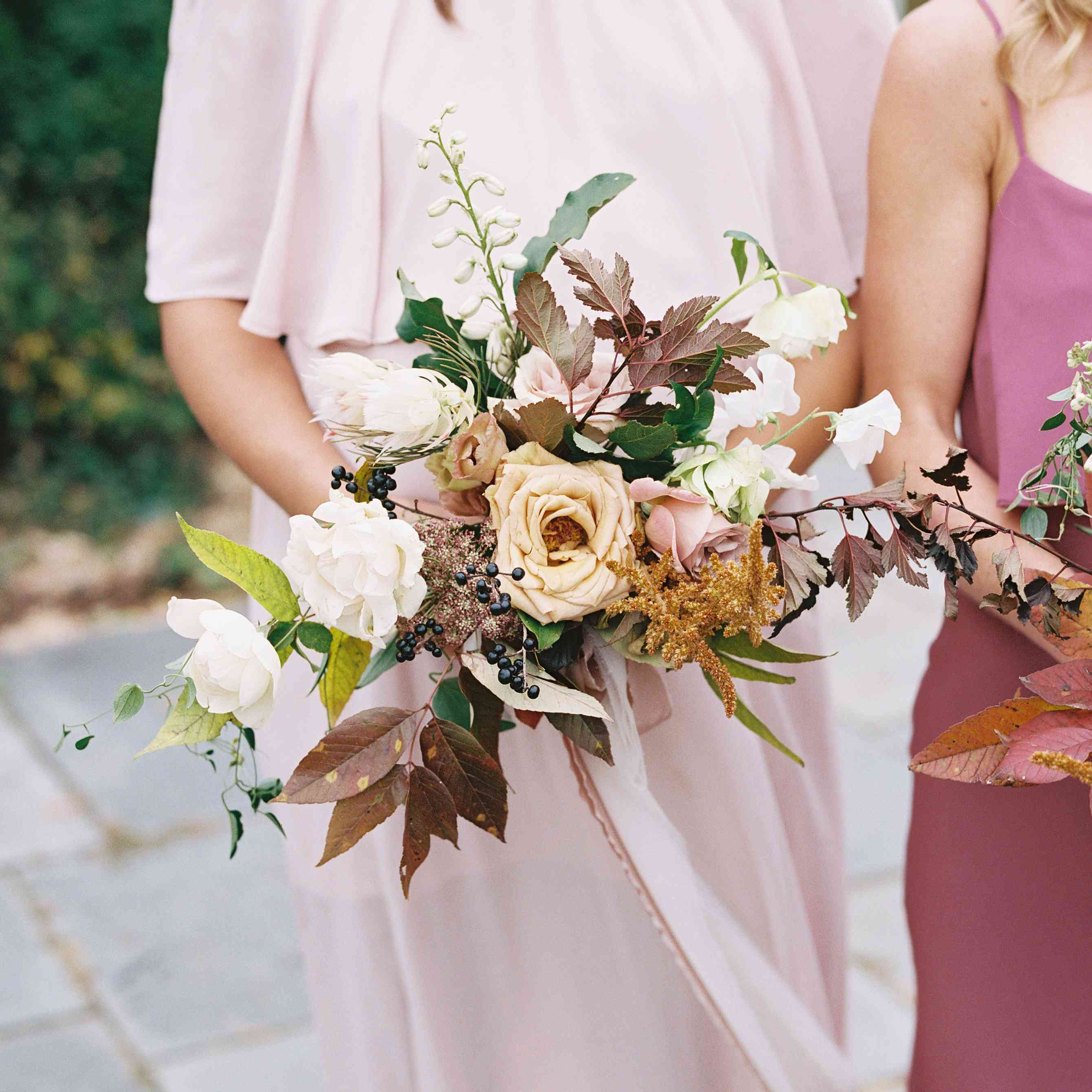 Bridesmaid bouquet consisting of hellebores, Queen Anne's lace, and maidenhair fern