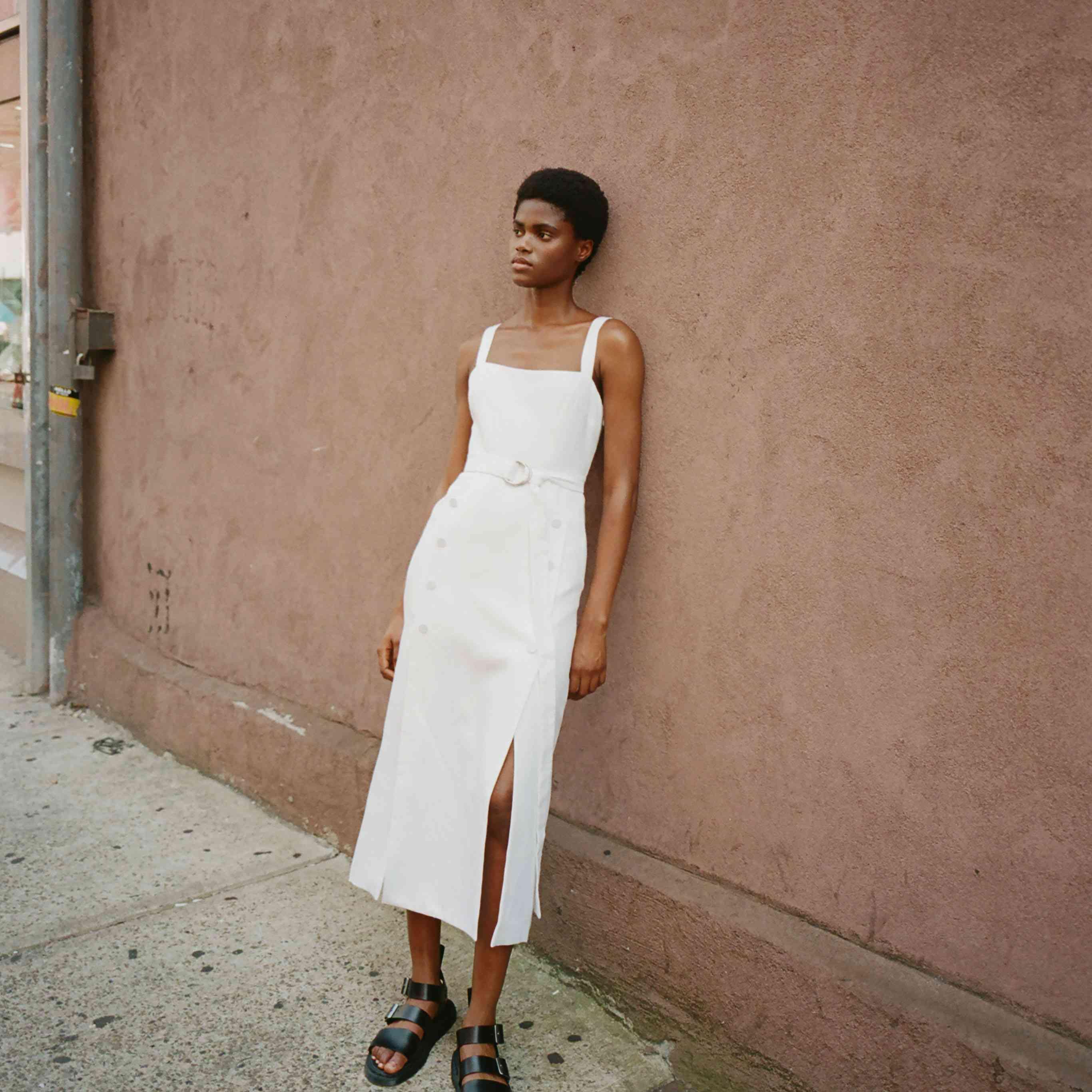 Model in sleeveless midi wedding dress