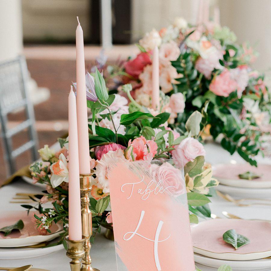 Blush pink candles on gold candelabra