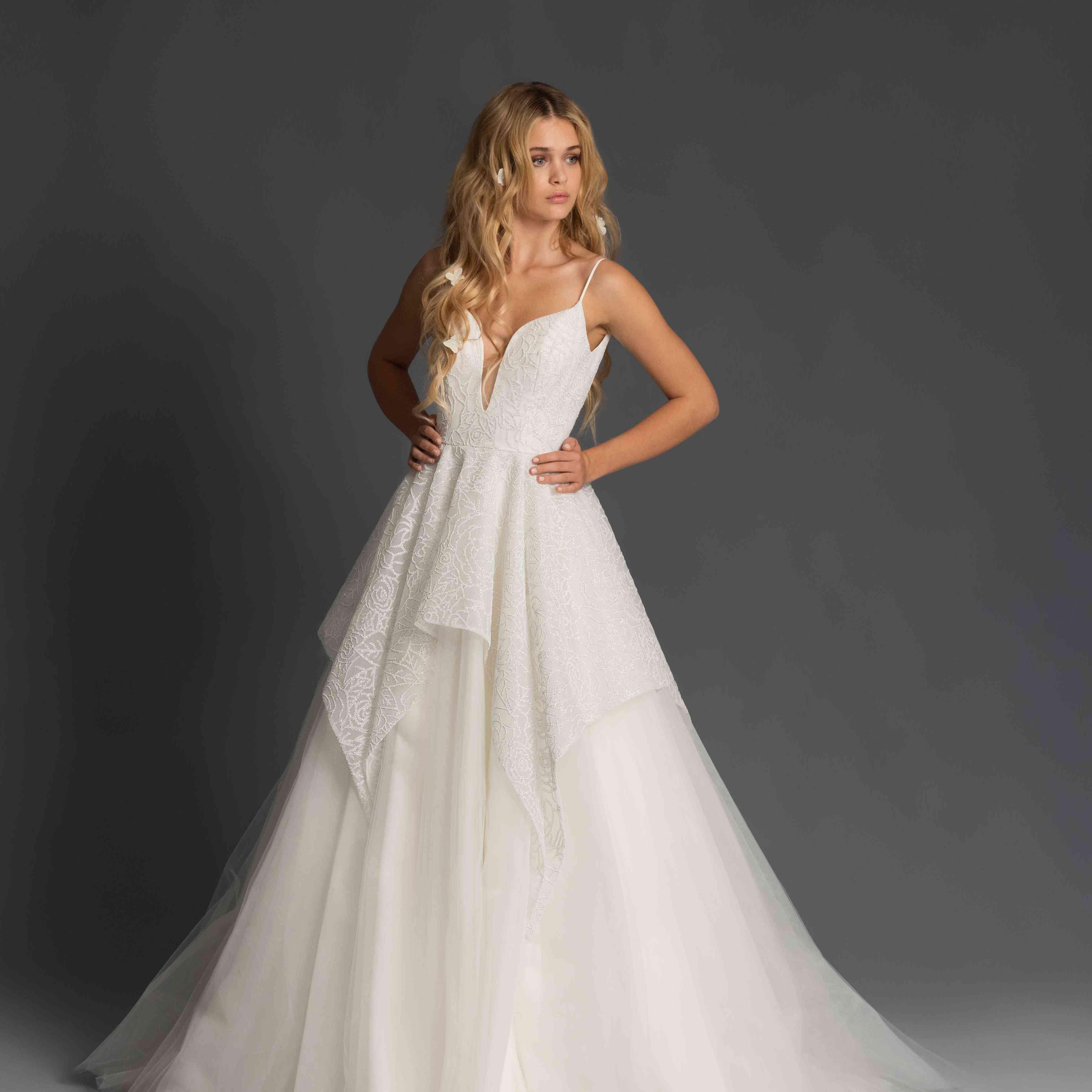Model in sleeveless peplum wedding dress