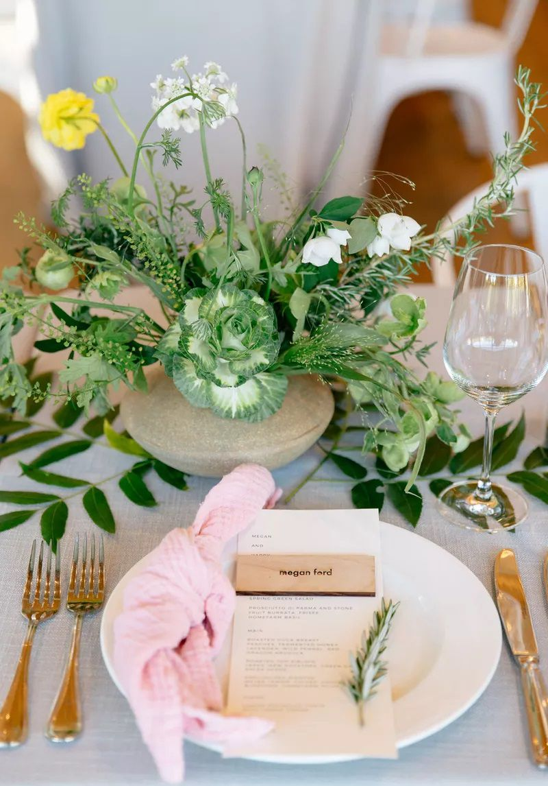 Wedding place setting with pink and greenery
