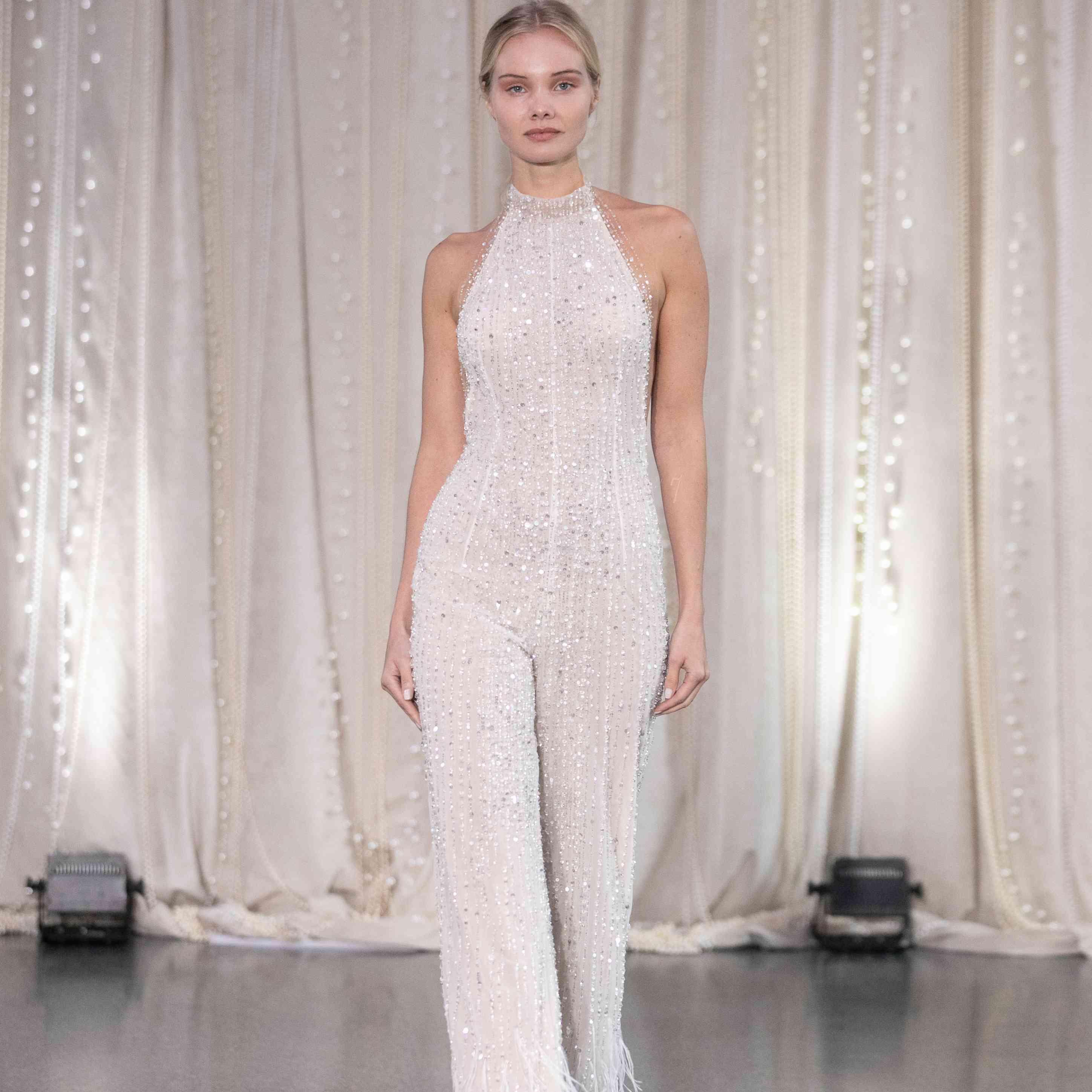Model in high neck beaded wedding jumpsuit